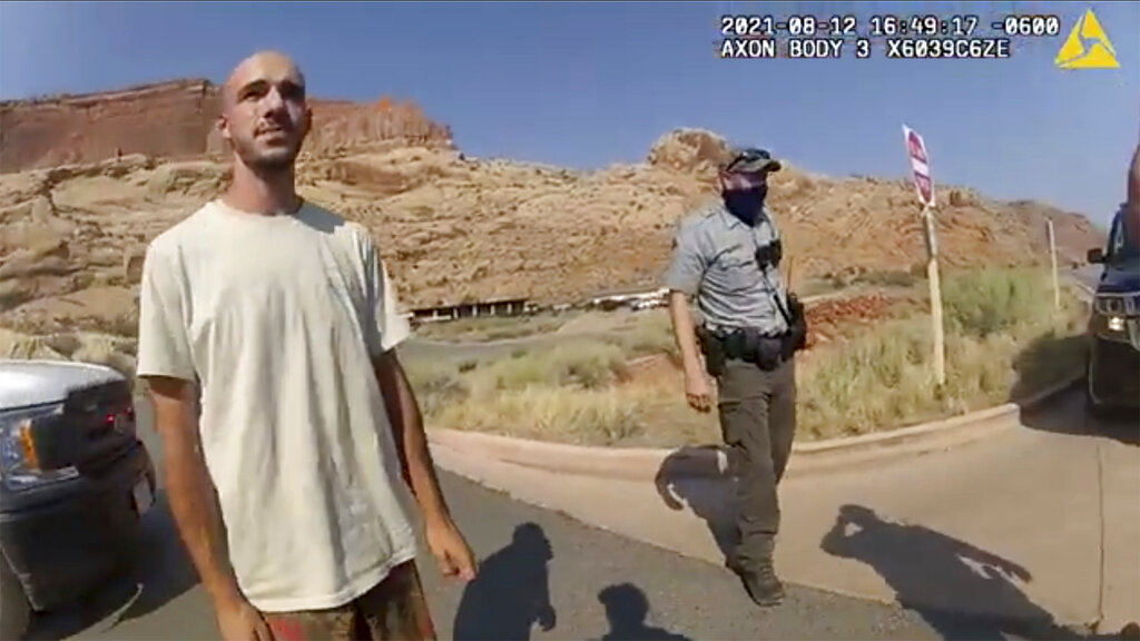 """Brian Laundrie talks to a police officer after police pulled over the van he was traveling in with Gabrielle """"Gabby"""" Petito."""