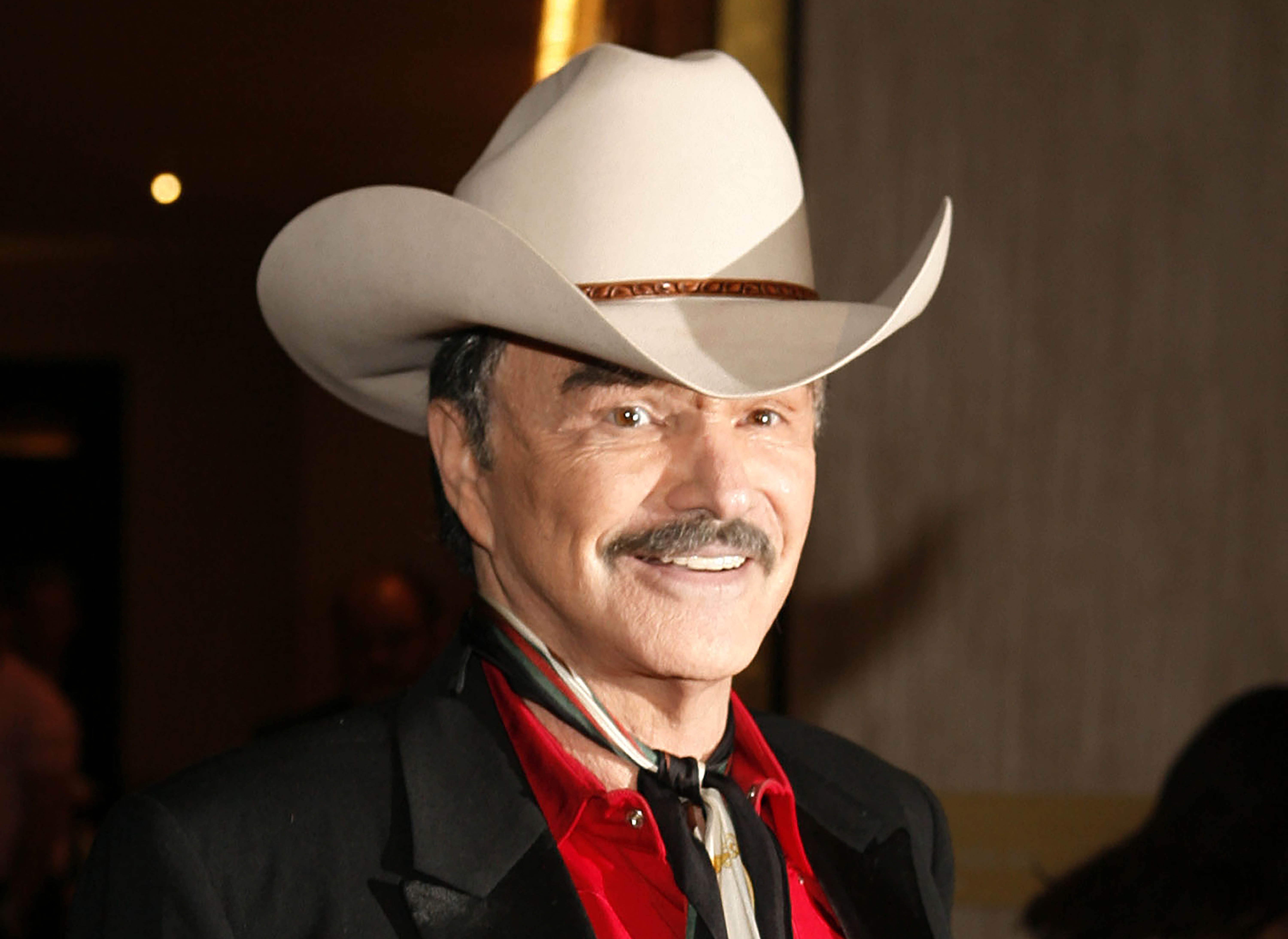 In this Aug. 12, 2006, file photo, actor Burt Reynolds poses for photographers at the Golden Boot Awards in Beverly Hills.