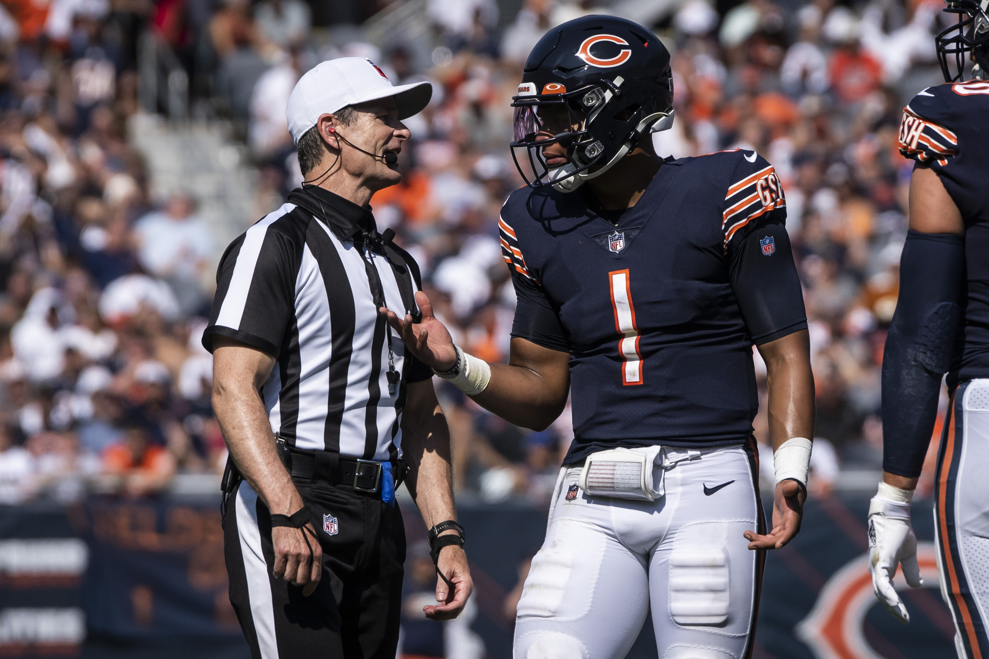 Bears quarterback Justin Fields talks to an official during Sunday's win against the Bengals.