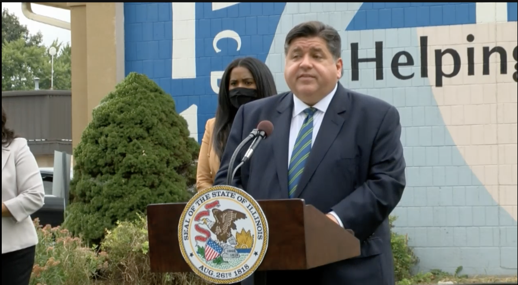 Gov. J.B. Pritzker announces funds for low-income families available through two state programs Monday.