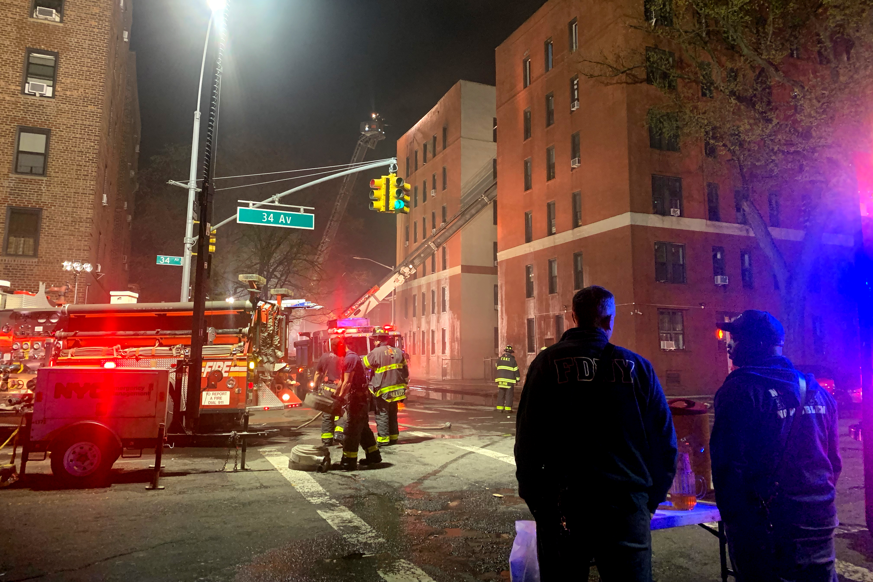 Firefighters at work after residential fire in Jackson Heights, April 2021