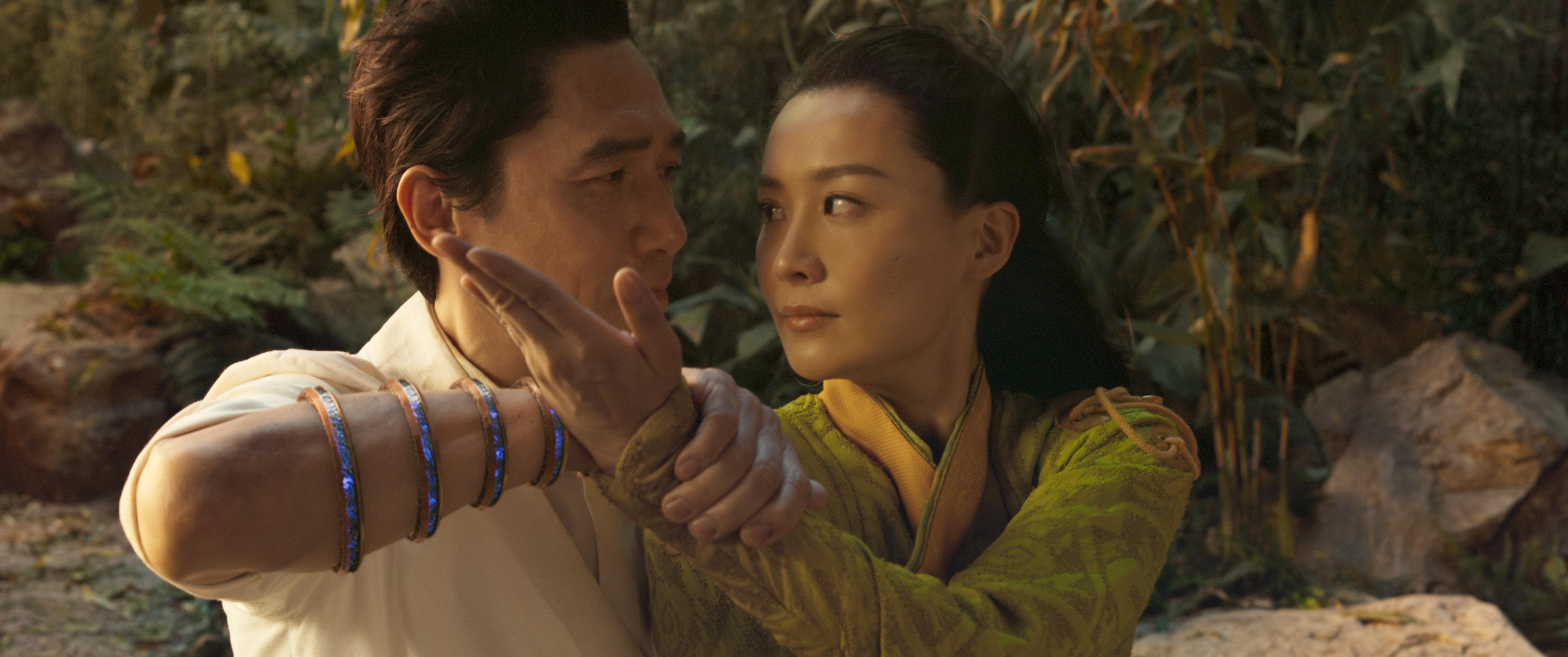 Tony Leung as Wenwu and Fala Chen as Jiang Li in a combative embrace.