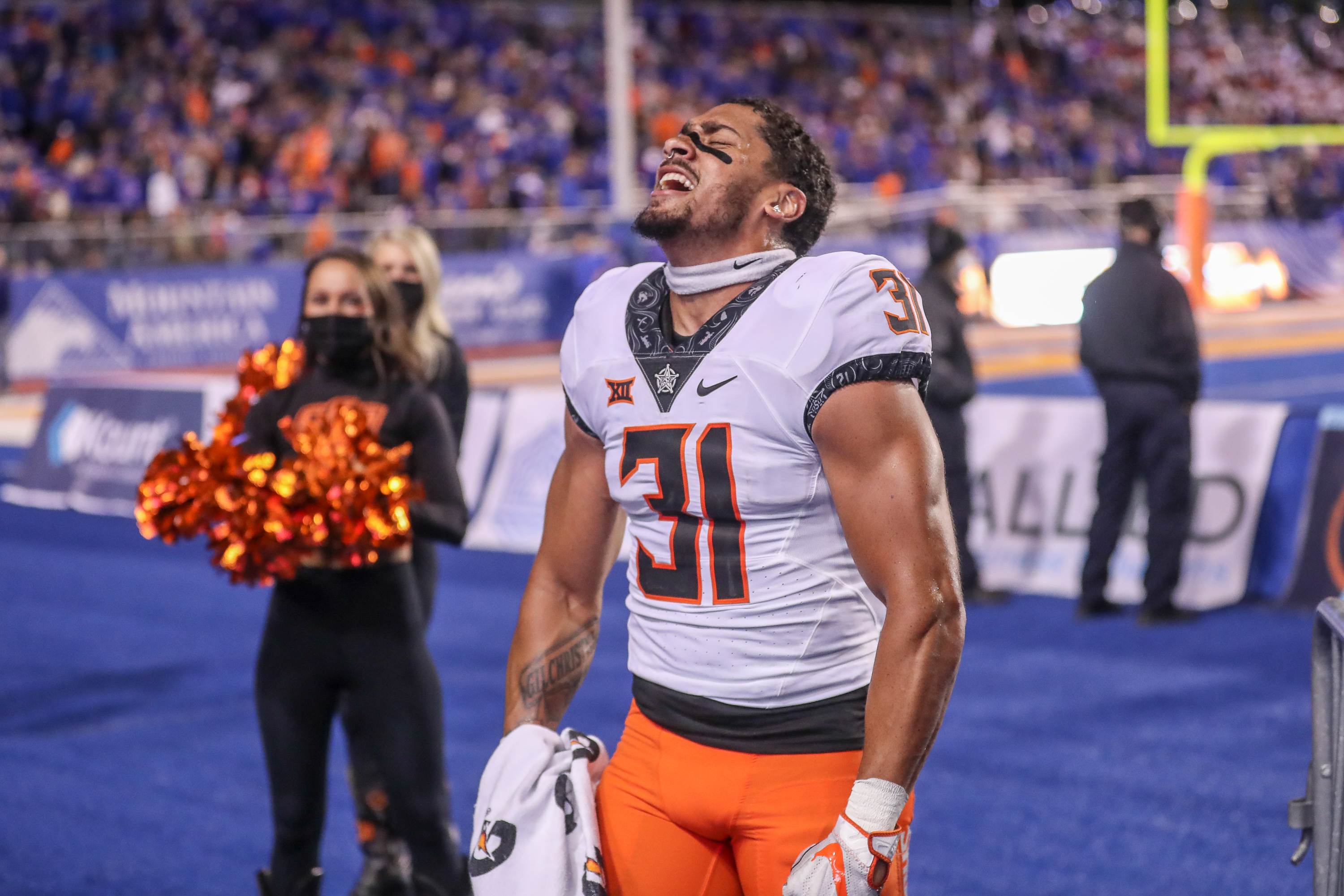 Safety Kolby Harvell-Peel of the Oklahoma State Cowboys celebrates the win at the conclusion of second half action against the Boise State Broncos on September 18, 2021 at Albertsons Stadium in Boise, Idaho.