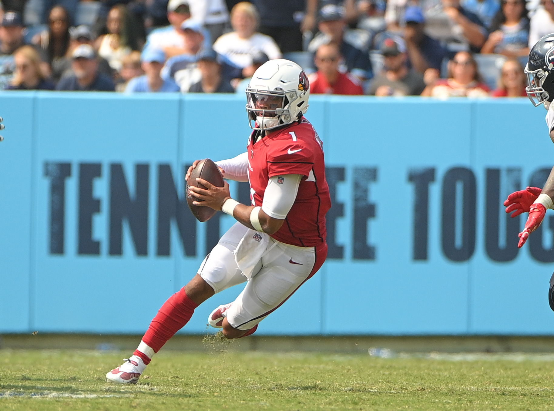 Arizona Cardinals quarterback Kyler Murray (1) runs with the ball against the Tennessee Titans during the second half at Nissan Stadium.