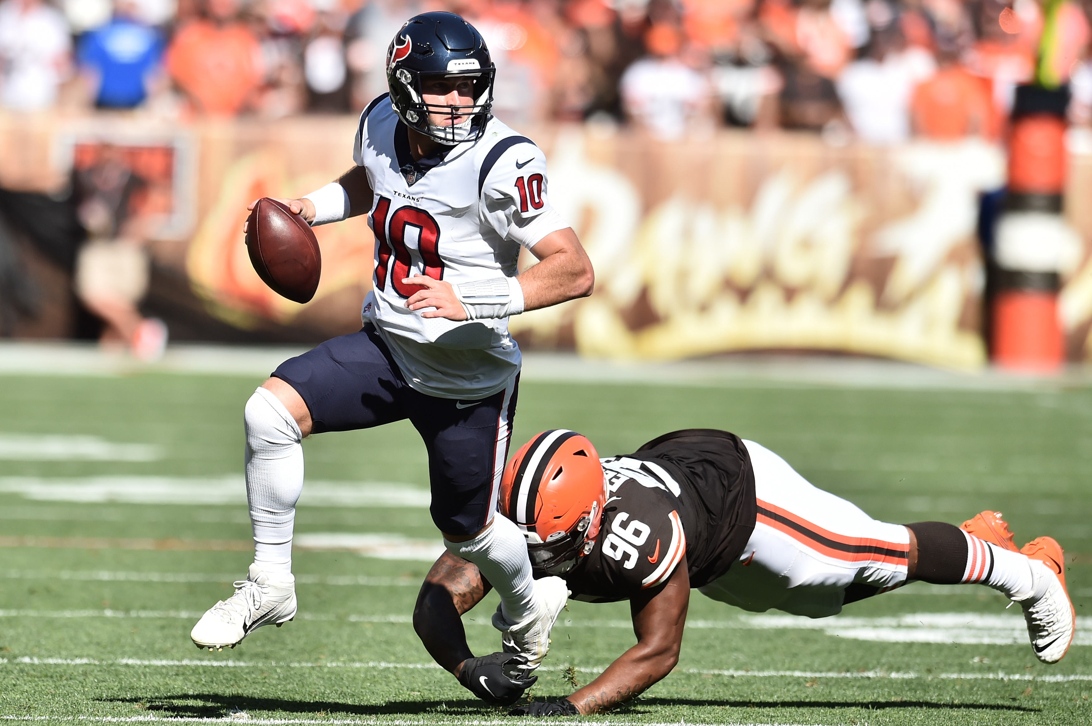 Houston Texans quarterback Davis Mills (10) scrambles away from Cleveland Browns defensive tackle Jordan Elliott (96) during the second half at FirstEnergy Stadium.