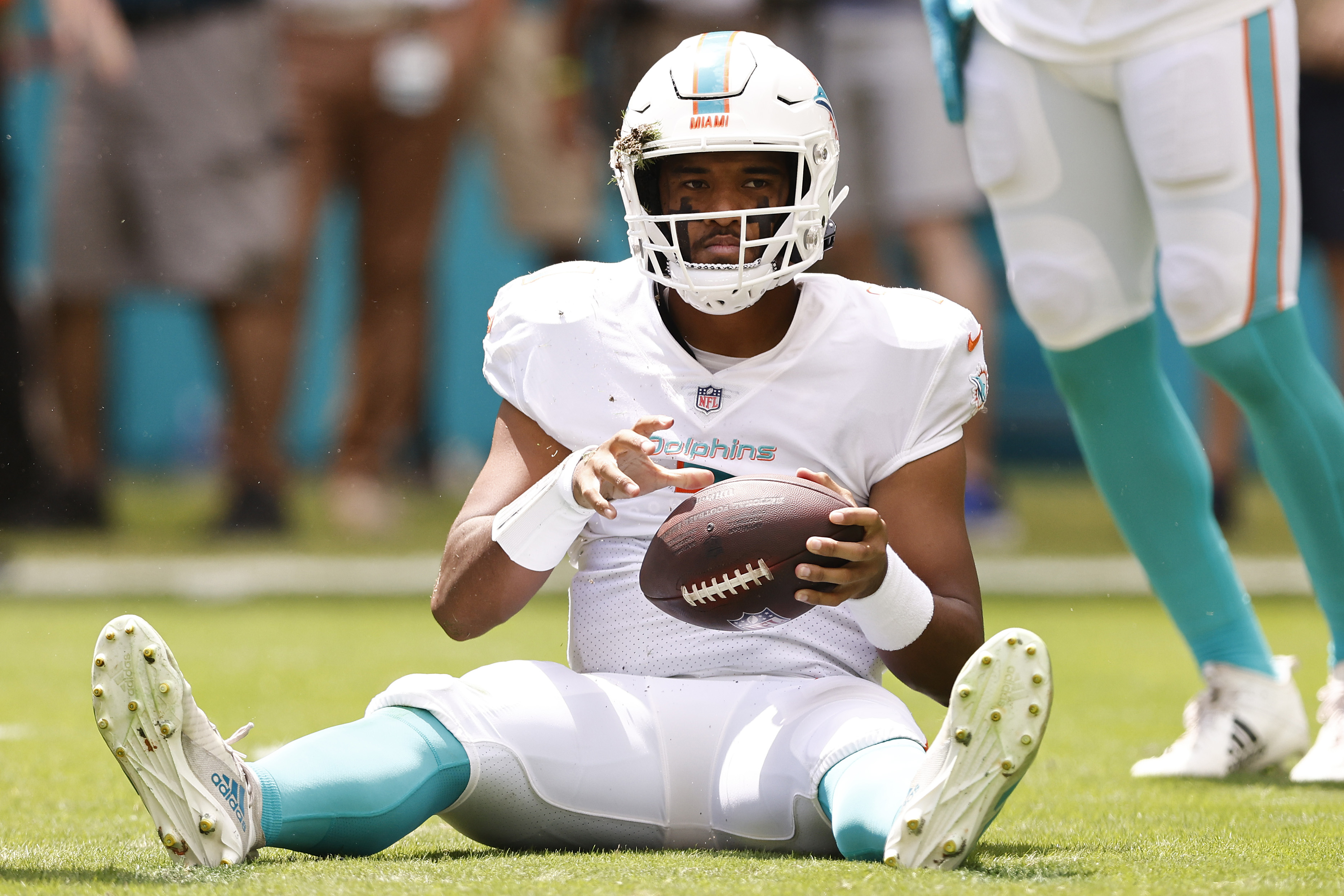 Tua Tagovailoa #1 of the Miami Dolphins reacts after being sacked against the Buffalo Bills during the first quarter at Hard Rock Stadium on September 19, 2021 in Miami Gardens, Florida.