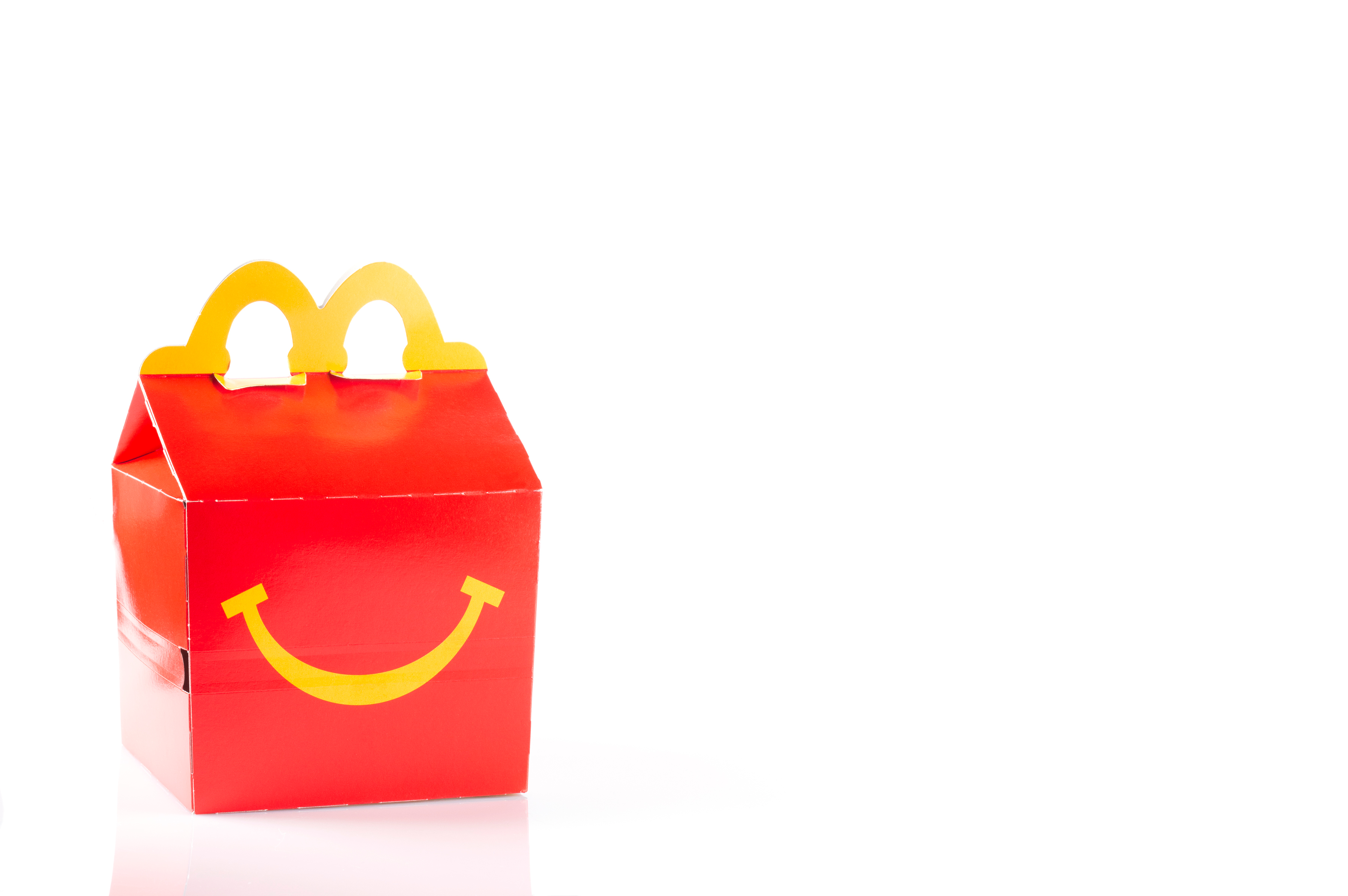 A red McDonald's Happy Meal box framed against an all-white background.