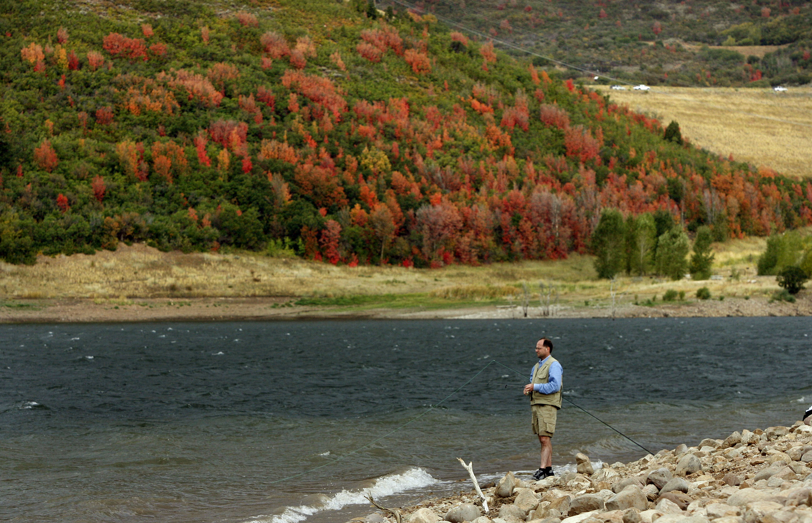 A fly fisherman enjoys the fall scenery as he fishes on Jordanelle Reservoir in Summit County, Utah.