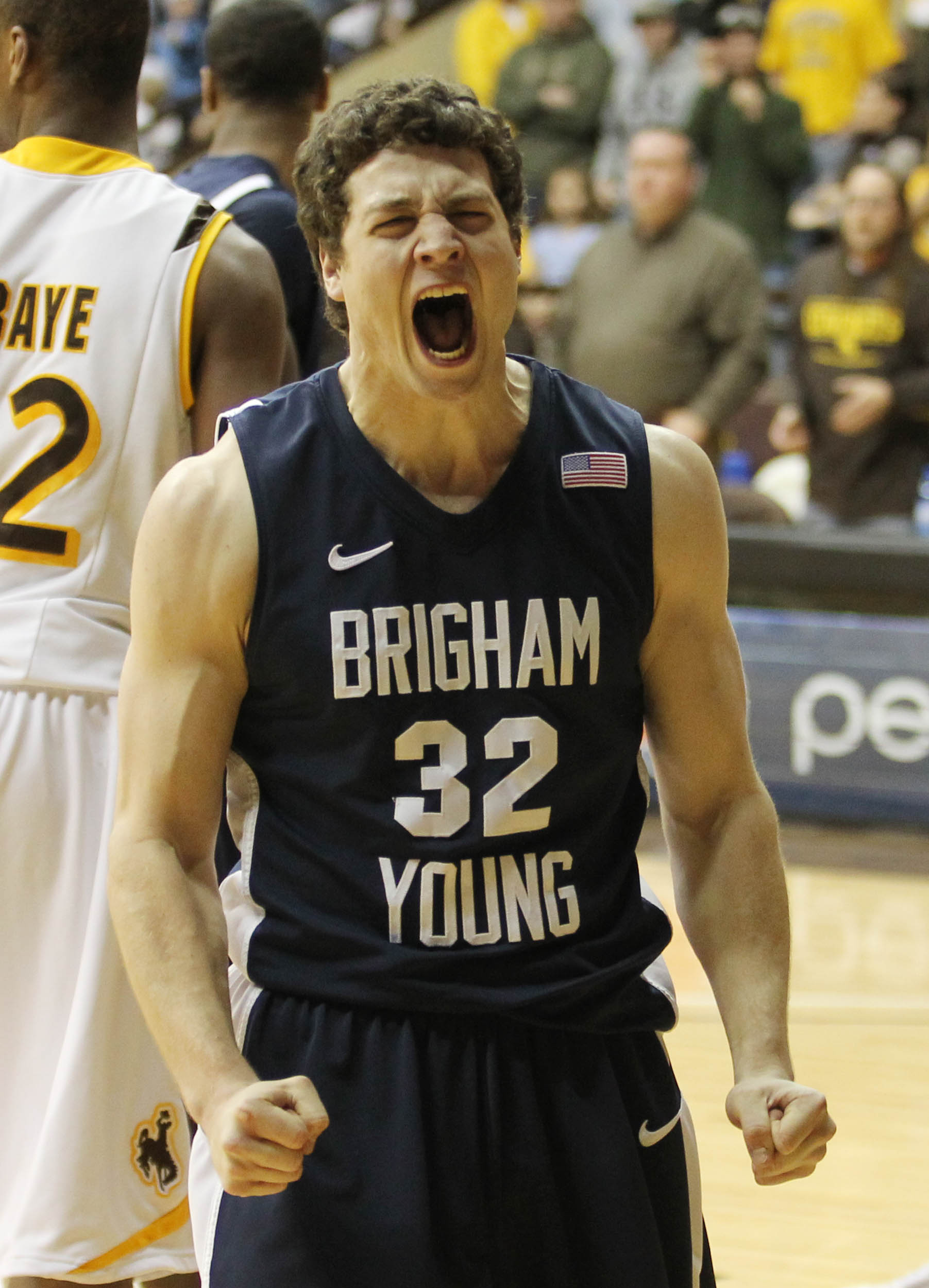 BYU guard Jimmer Fredette reacts after drawing a foul for a three-point play duringan NCAA college basketball game against Wyoming on Wednesday, Feb. 2, 2011, at the Arena-Auditorium in Laramie, Wyo. BYU won 69-62. (AP Photo/Andy Carpenean) n)