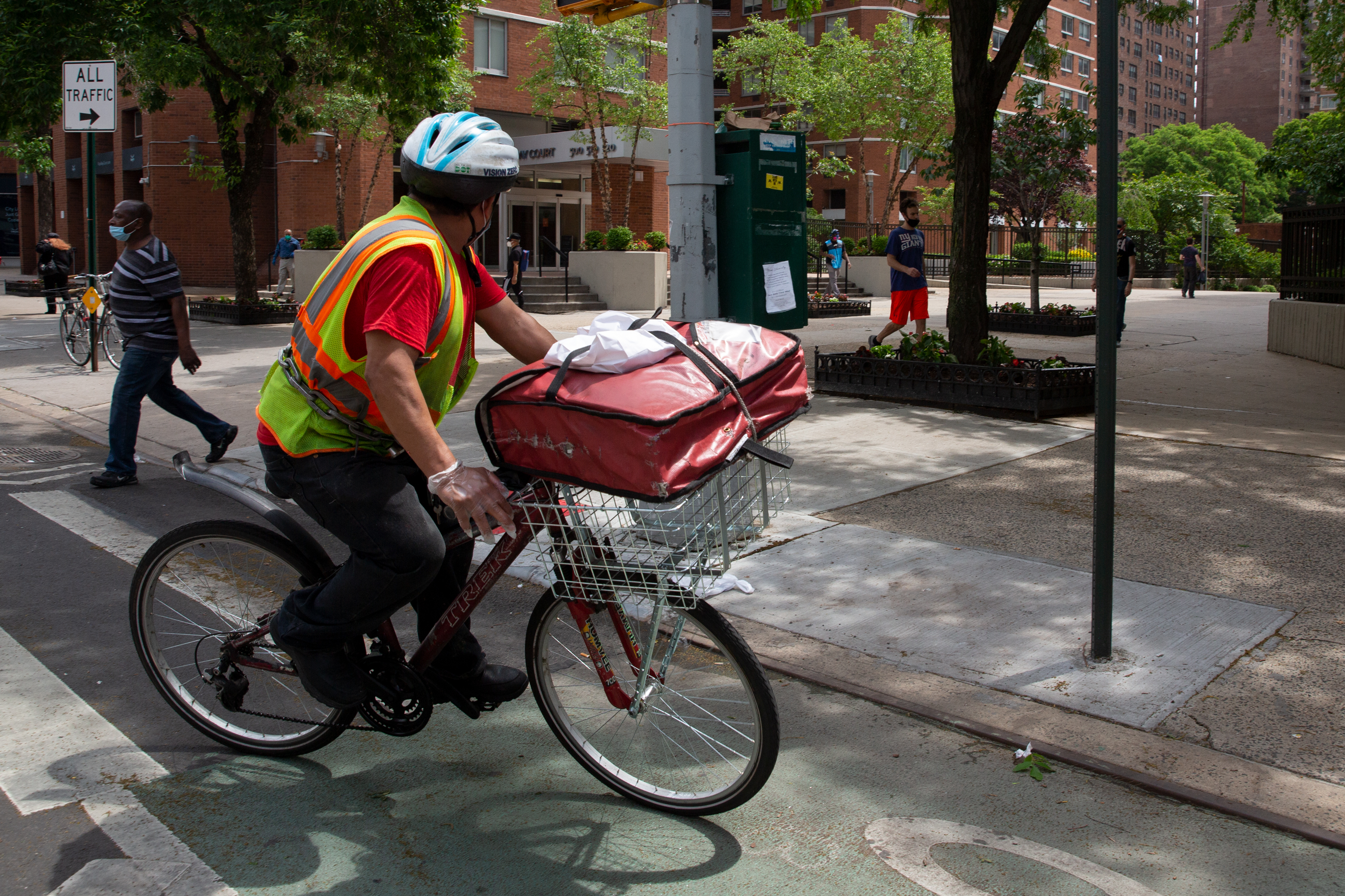 A delivery worker cycles through Kips Bay in Manhattan, June 4, 2020.