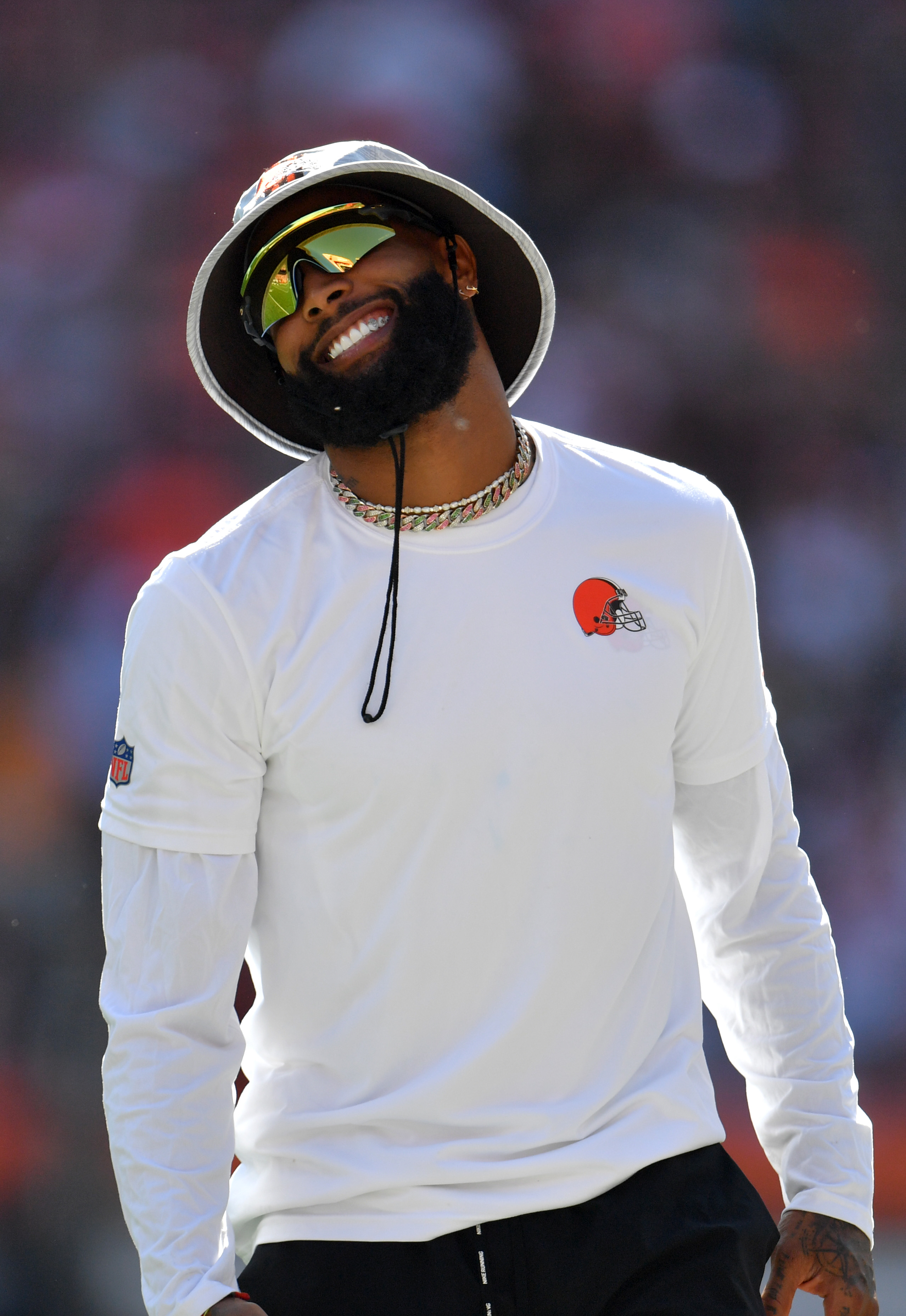 Wide receiver Odell Beckham Jr. #13 of the Cleveland Browns on the field but not in uniform today before the game against the Houston Texans at FirstEnergy Stadium on September 19, 2021 in Cleveland, Ohio.