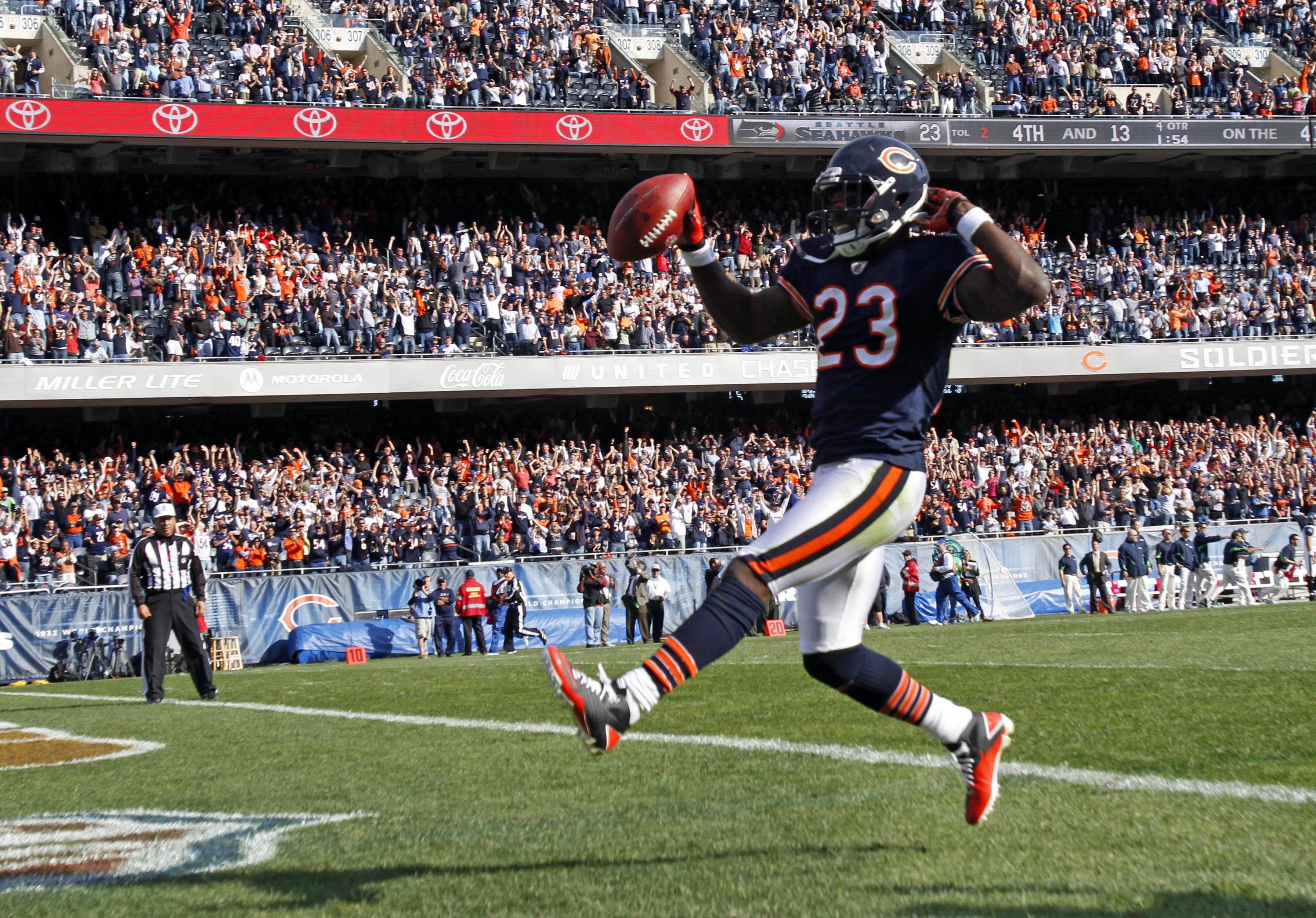 Former Bears returner Devin Hester scores a touchdown in 2010.