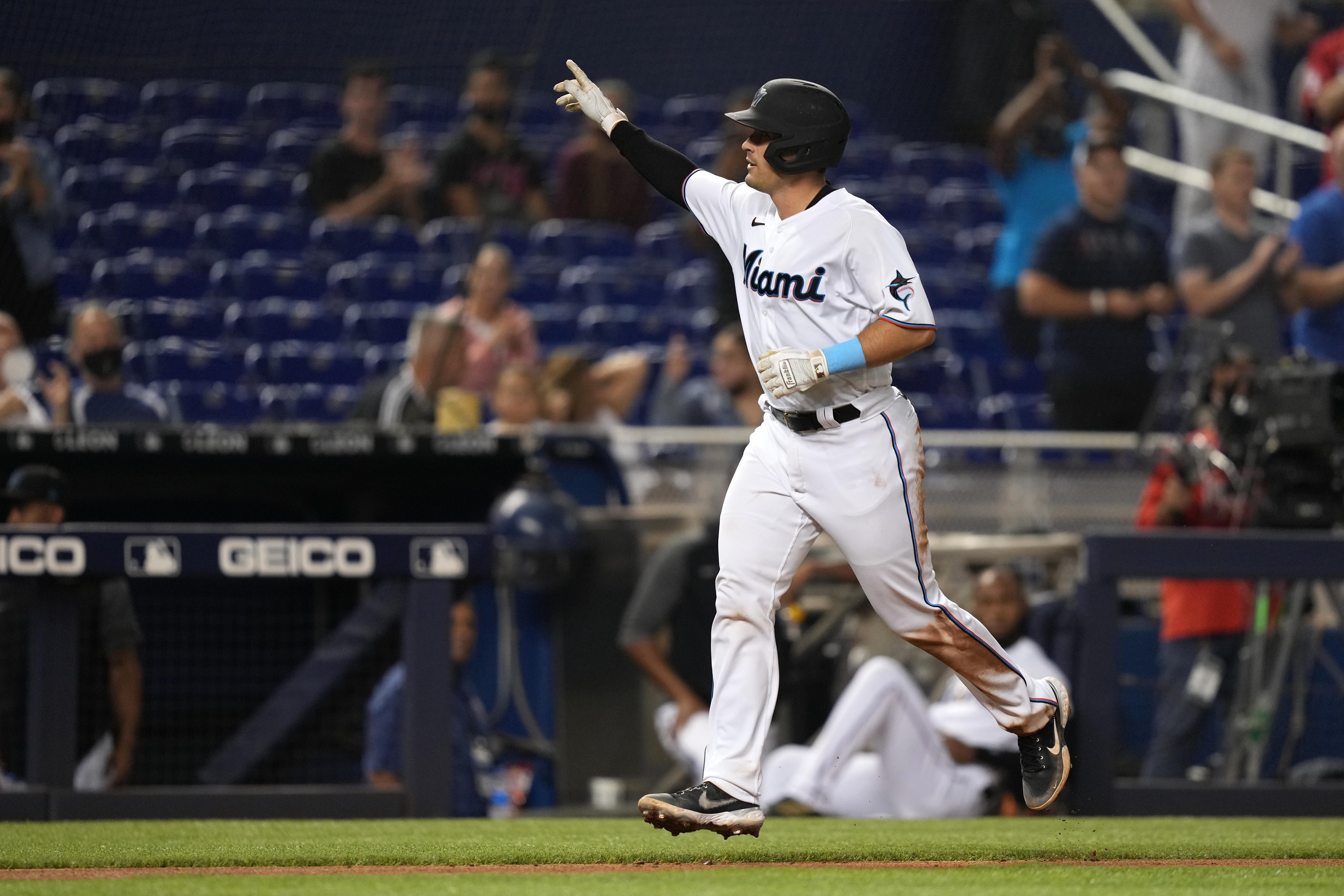 Miami Marlins catcher Nick Fortes (84) celebrates his solo home run while rounding the bases in the 5th inning against the Washington Nationals at loanDepot park