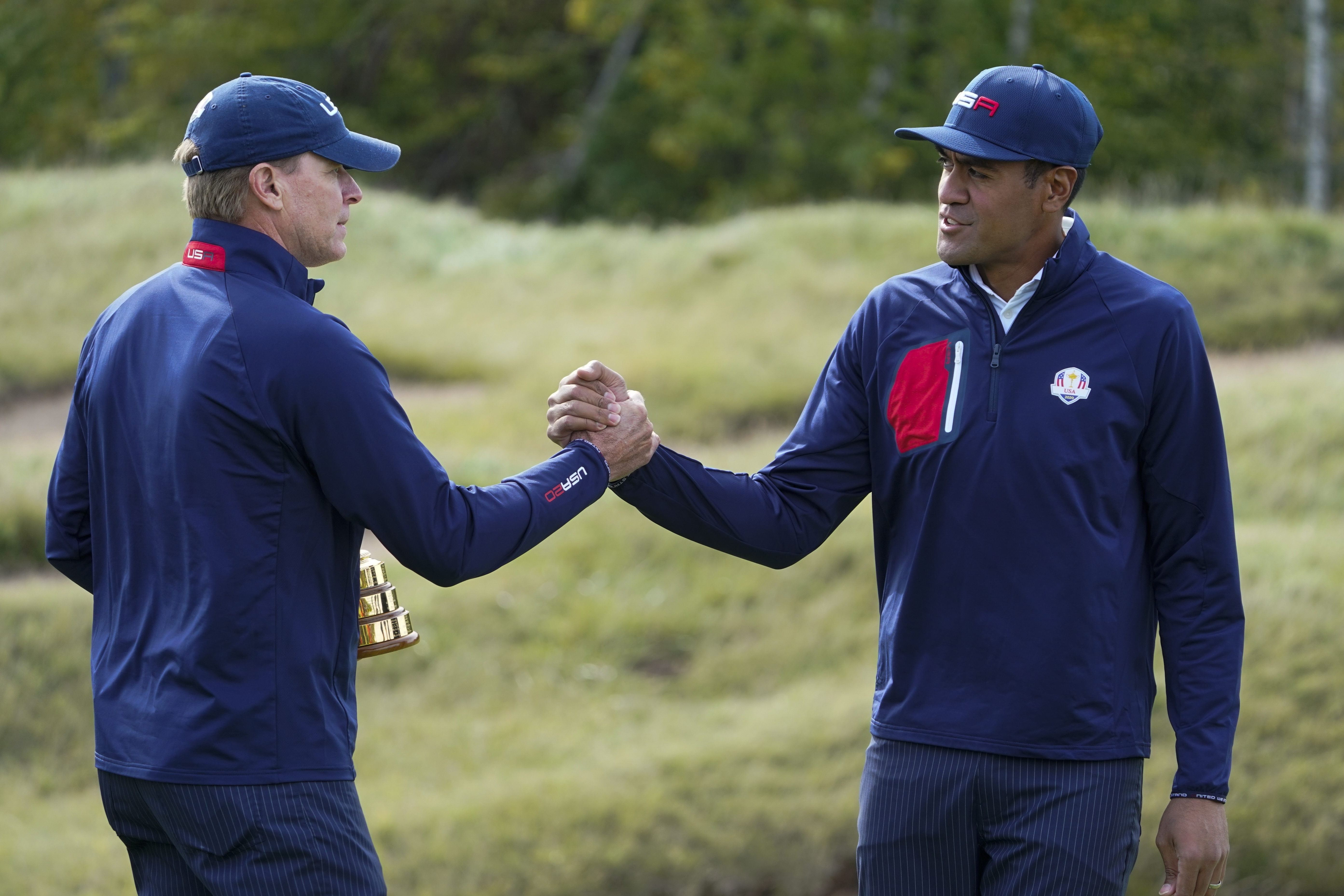 Team USA captain Steve Stricker shakes hands with Team USA's Tony Finau during a practice day at the Ryder Cup.