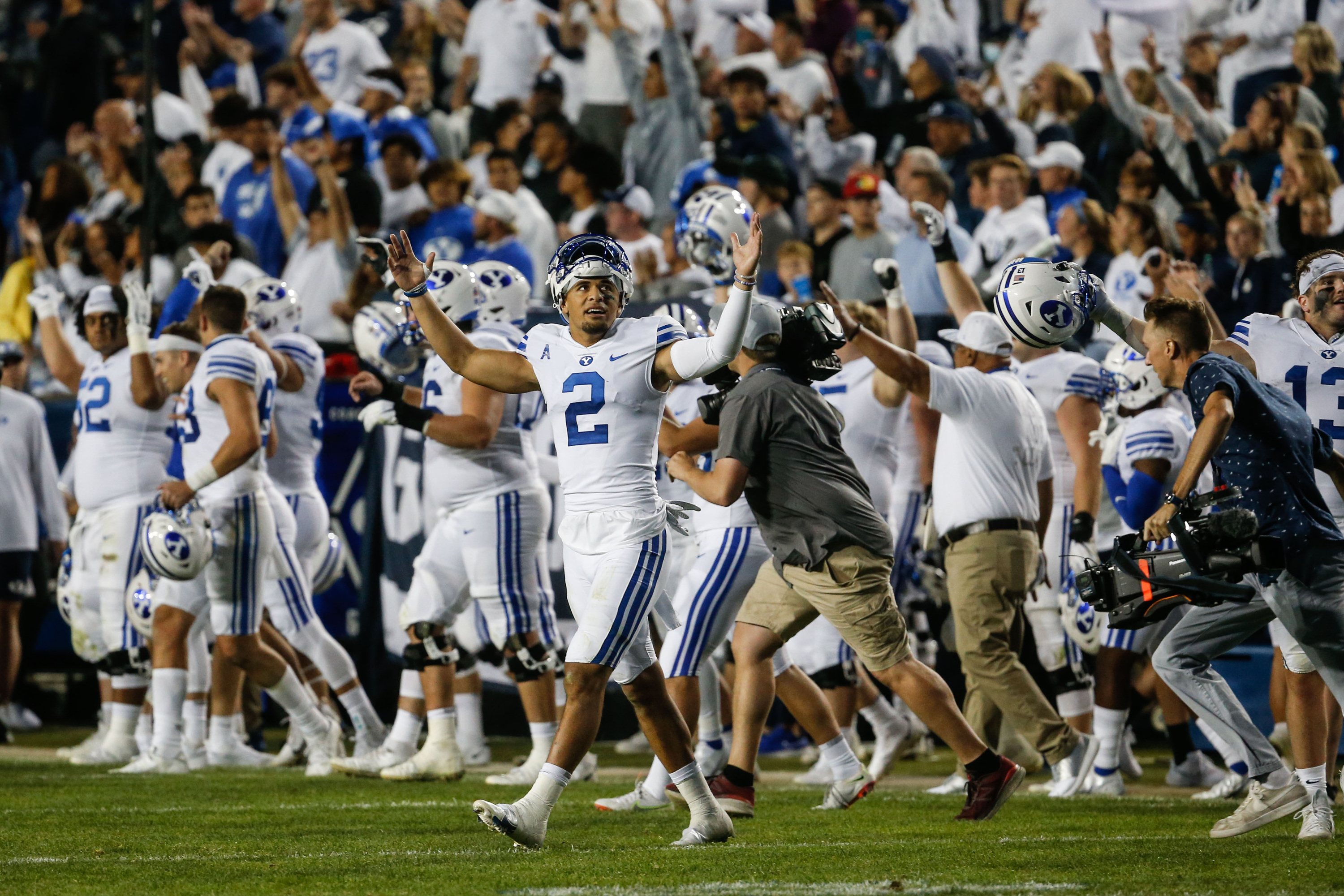 BYU players celebrate after defeating Arizona State at LaVell Edwards Stadium in Provo on Saturday, Sept. 18, 2021.