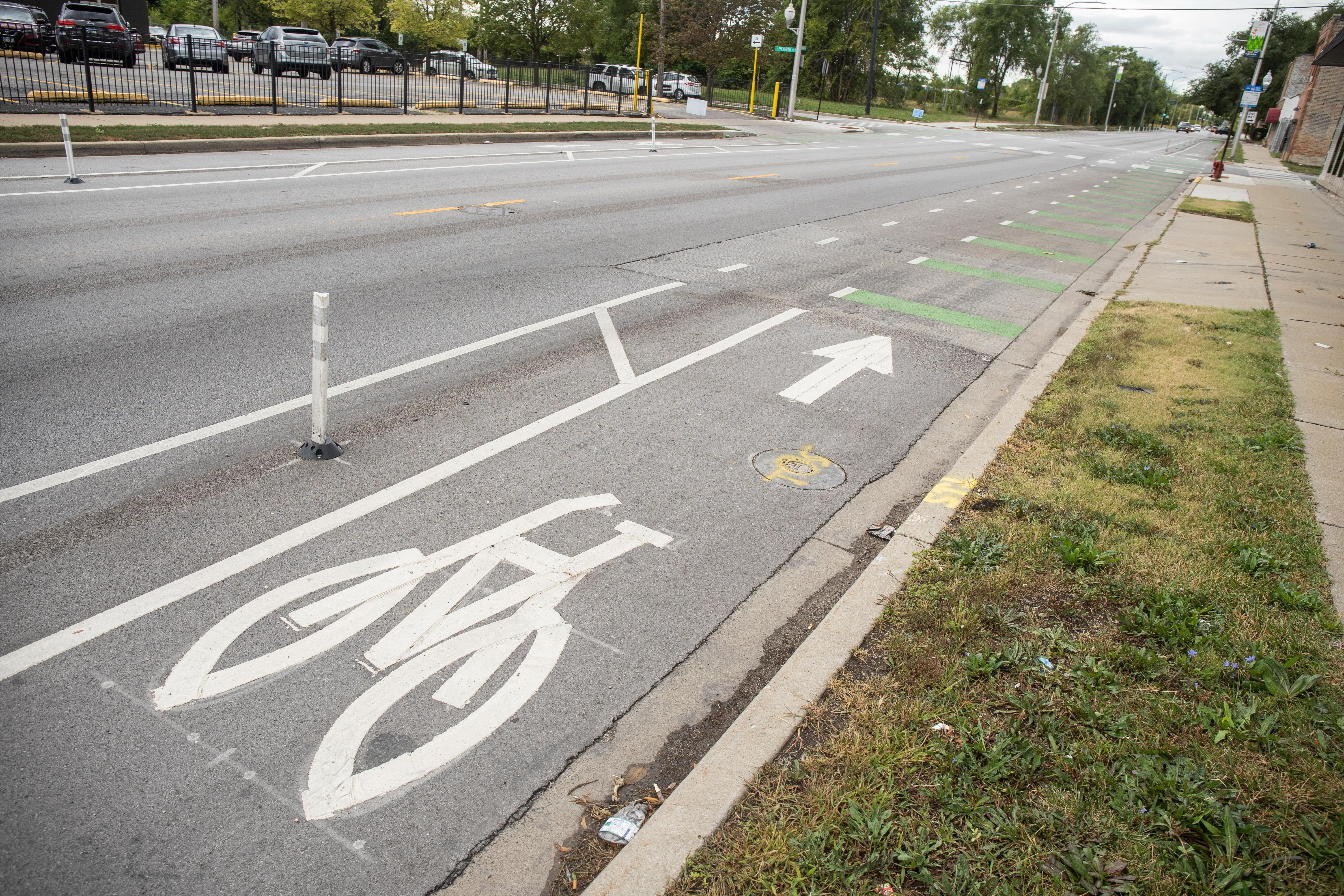 A new bike lane along West 119th Street and South Green Street in the West Pullman neighborhood is seen in this photo, Wednesday morning, Sept. 22, 2021. The Chicago Department of Transportation announced Wednesday that they are upgrading and building 100 miles of bike lanes across the city with the help of Chicago Mayor Lori Lightfoot's Chicago Works capital plan.