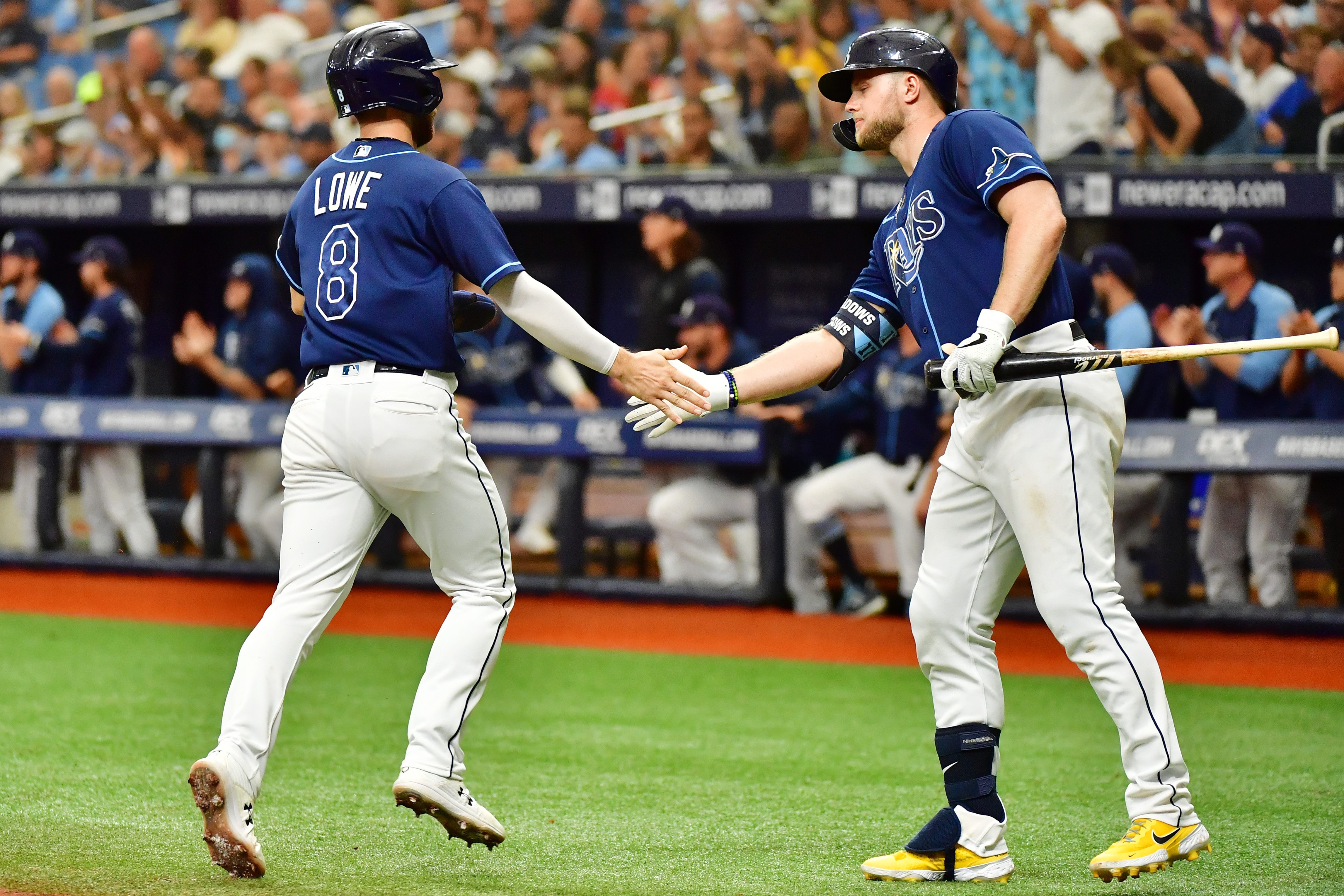 Austin Meadows #17 celebrates with Brandon Lowe #8 of the Tampa Bay Rays after a run in the third inning against the Toronto Blue Jays at Tropicana Field on September 22, 2021 in St Petersburg, Florida.
