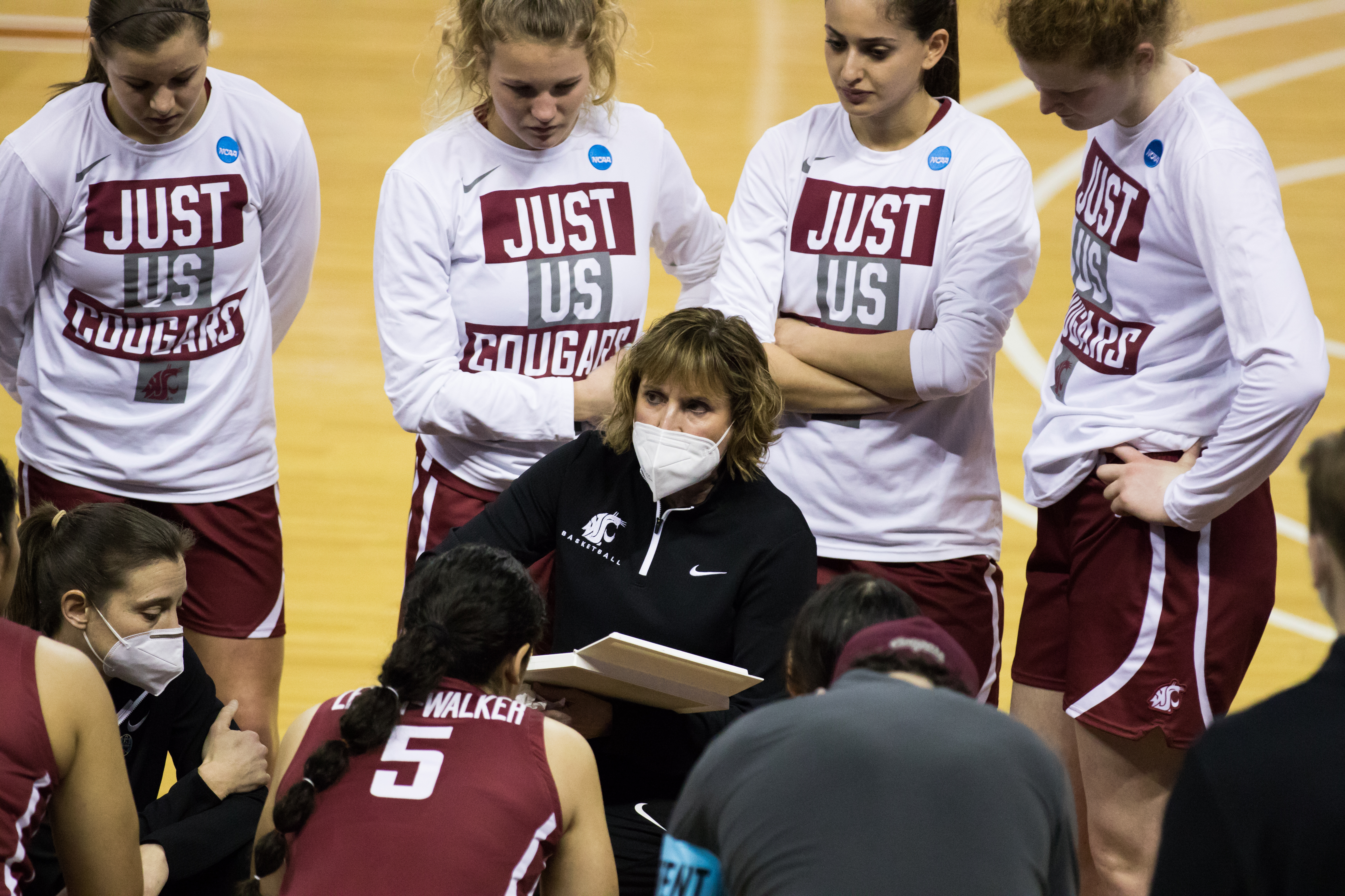 AUSTIN, TX - MARCH 21: Washington State head coach Kamie Ethridge talks to her team prior to the Women's NCAA Tournament First Round matchup between the USF Bulls and the Washington State Cougars on March 21, 2021, at Frank Erwin Center in Austin, TX.