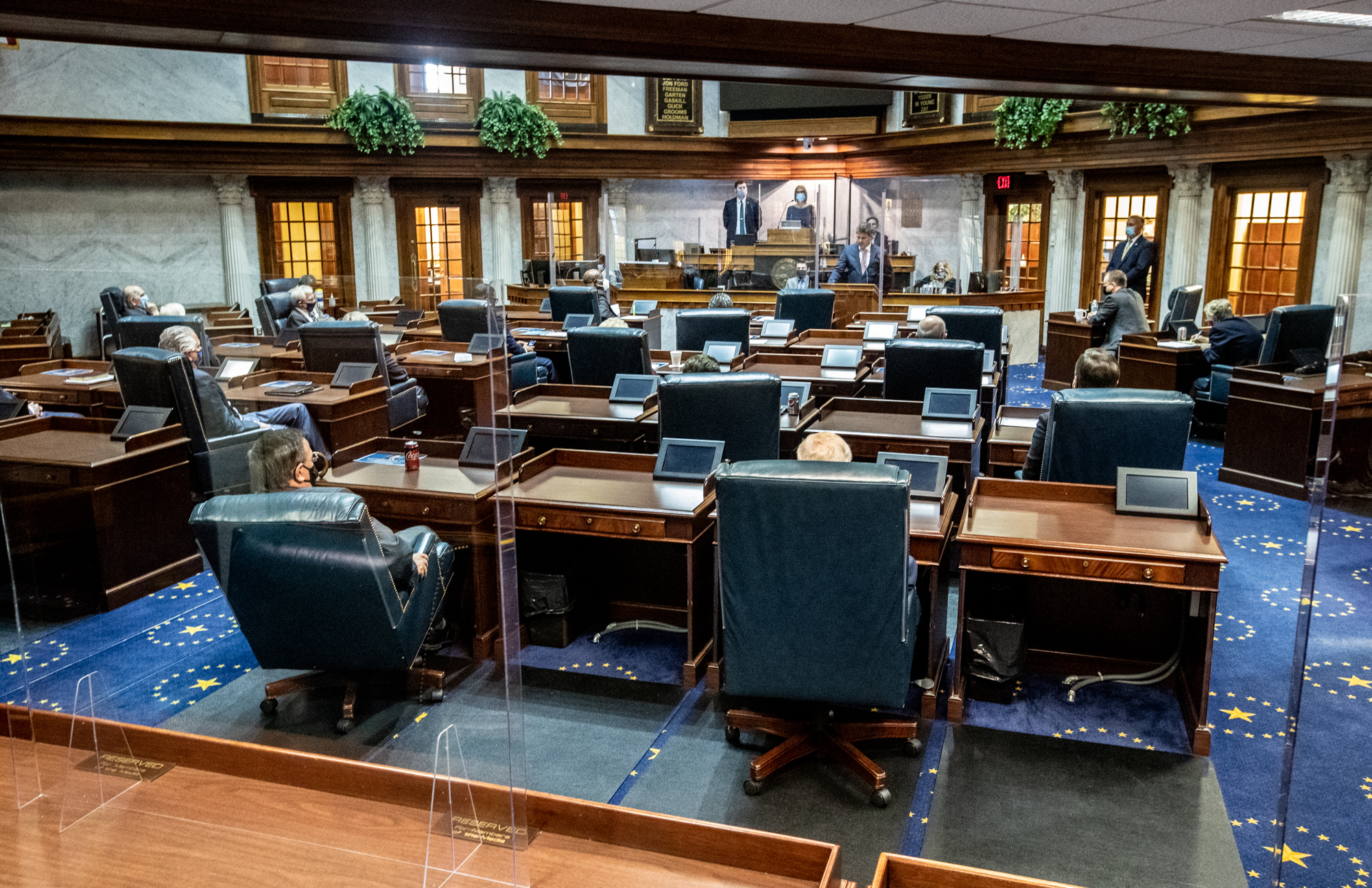 Lawmakers socially distance using the floor and balcony in the Indiana Senate chamber on Organization Day at the Indiana Statehouse.