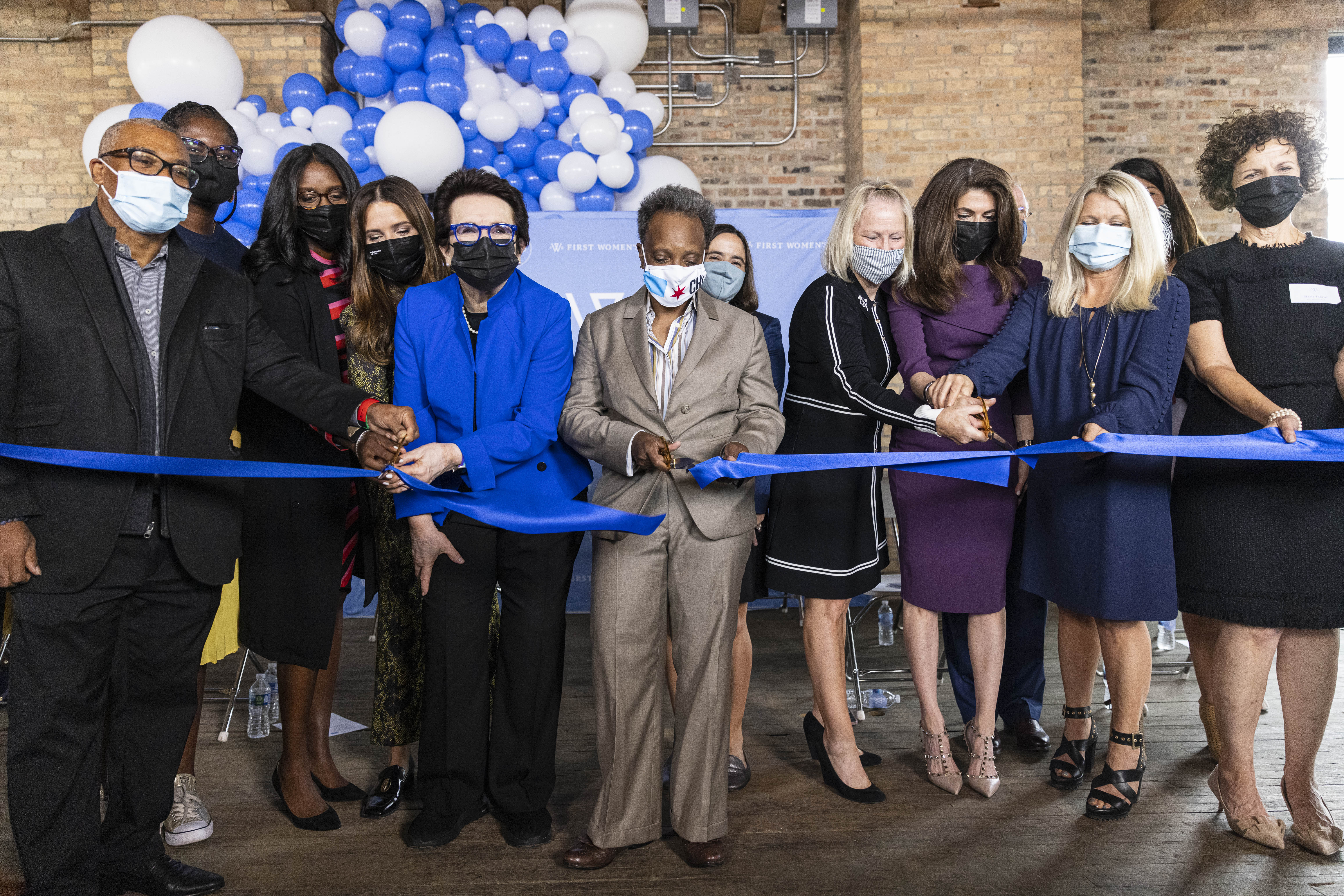 Activists, First Woman's Bank Board Members and City Officials cut the ribbon at a cutting ceremony at the First Women's Bank at 1308 N Elston Ave in Goose Island