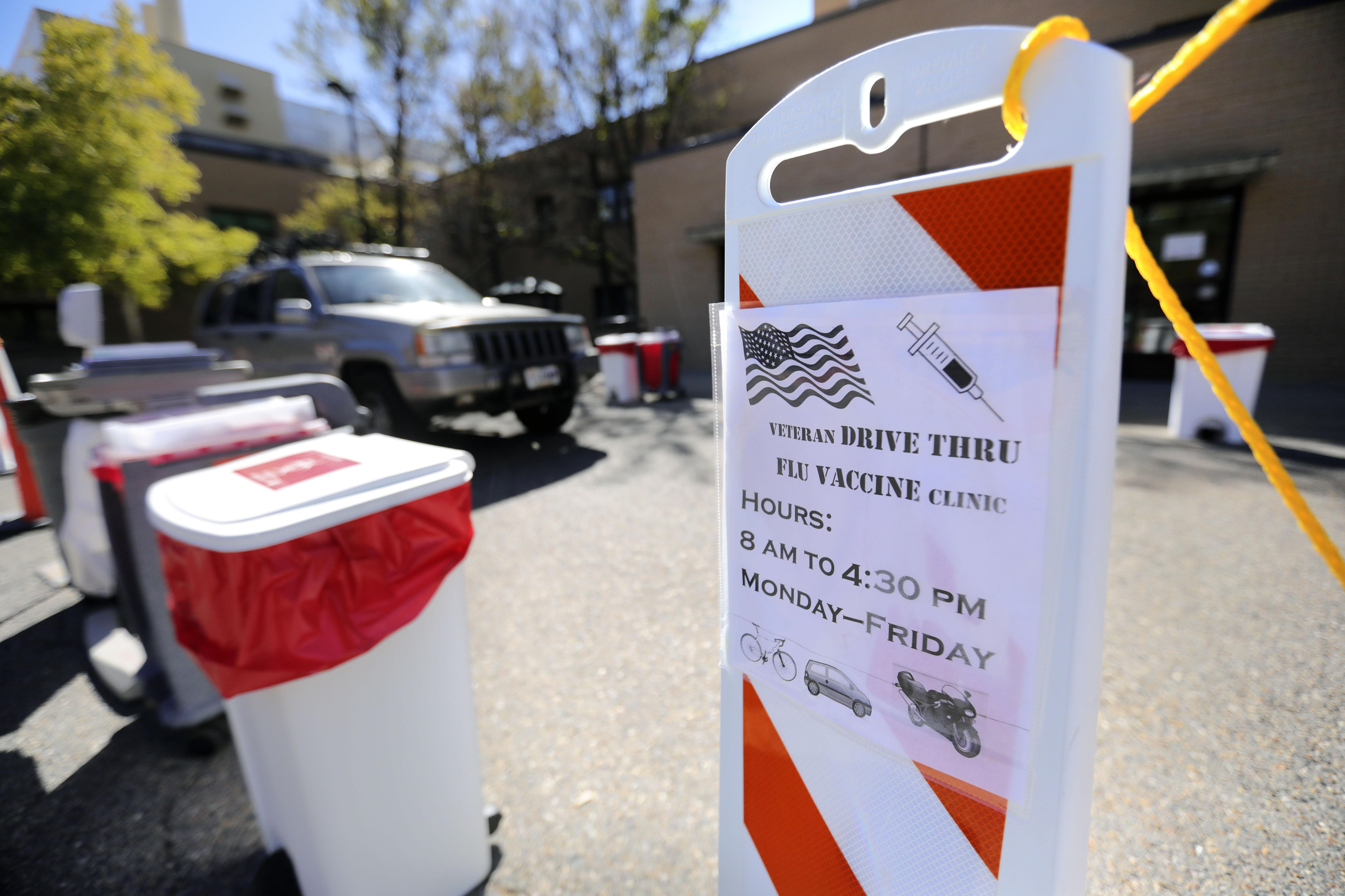 A veteran arrives at a drive-thru flu vaccine clinic.
