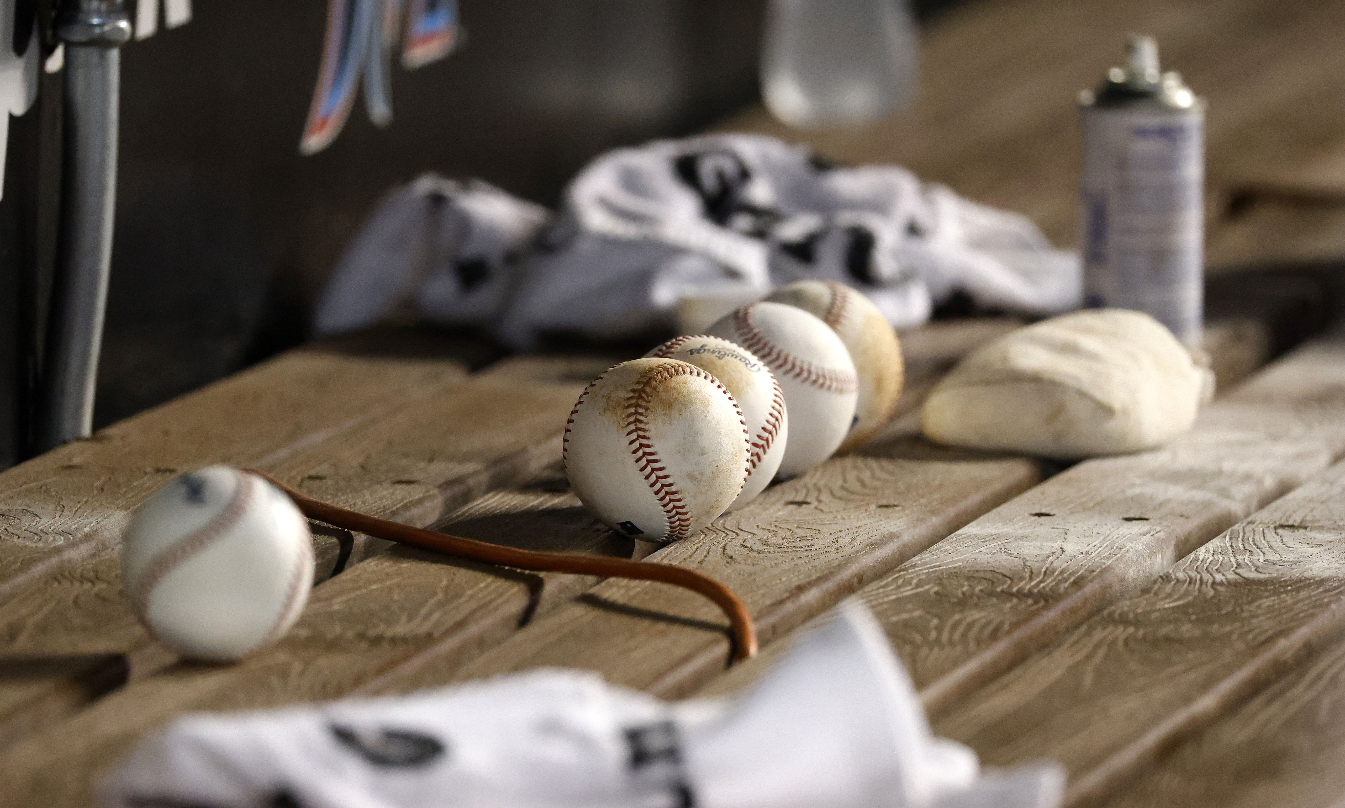 Baseballs sit in the Washington Nationals dugout during the fifth inning against the Miami Marlins at loanDepot Park