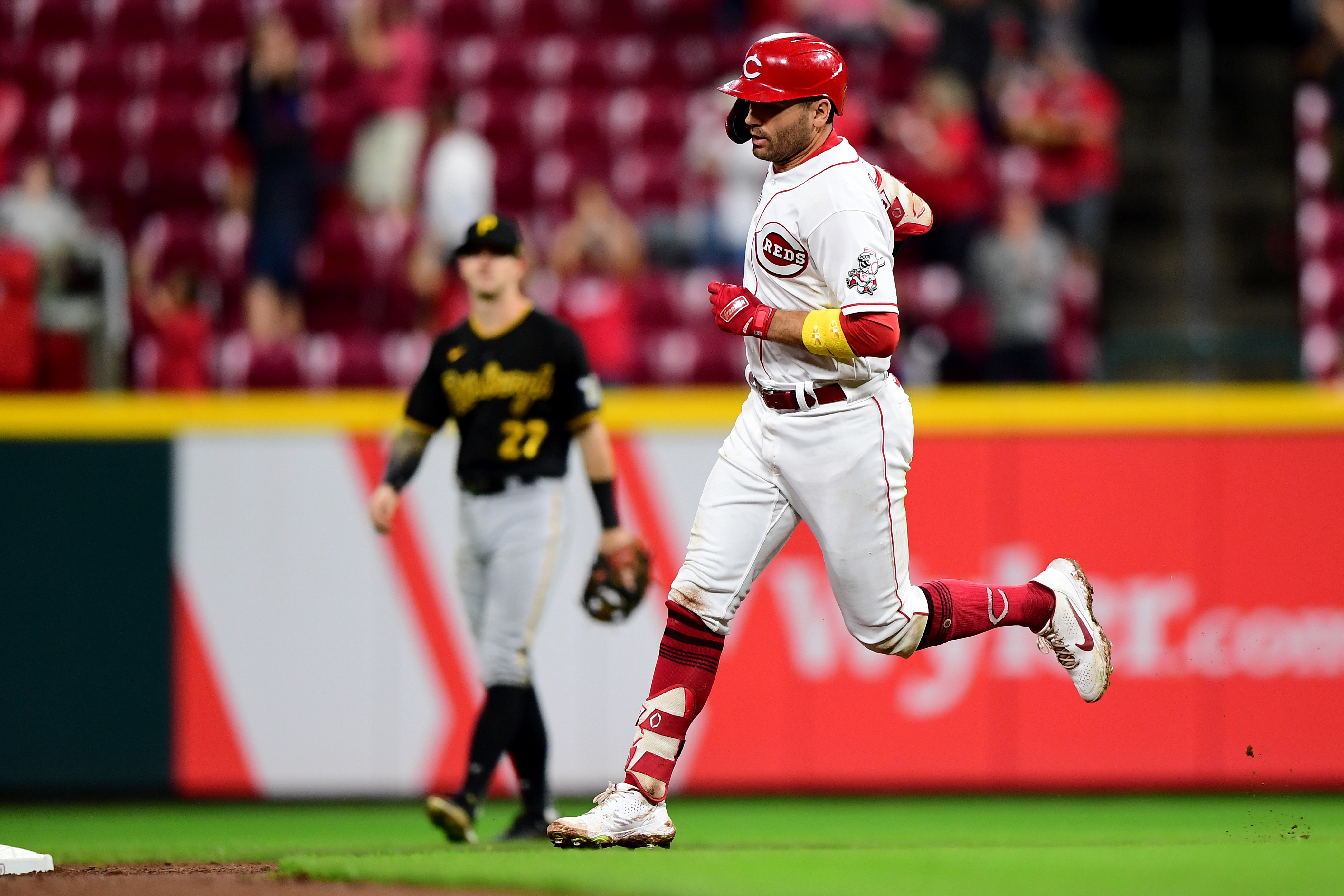 Joey Votto #19 of the Cincinnati Reds runs the bases after hitting a home run in the fifth inning during a game between the Cincinnati Reds and Pittsburgh Pirates at Great American Ball Park on September 20, 2021 in Cincinnati, Ohio.