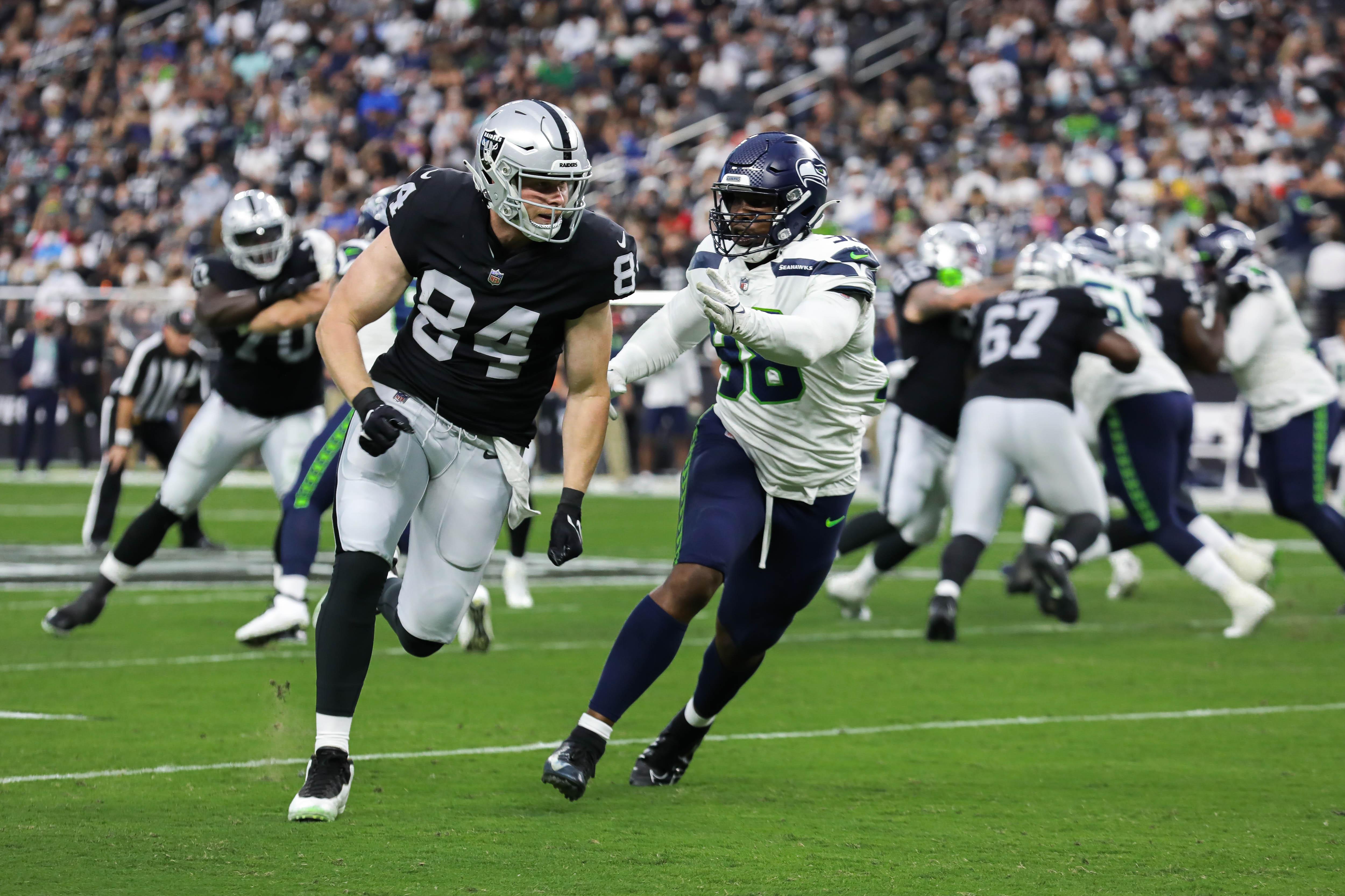 Las Vegas Raiders' tight end Matt Bushman (84) runs down the field during a preseason game against Seattle.