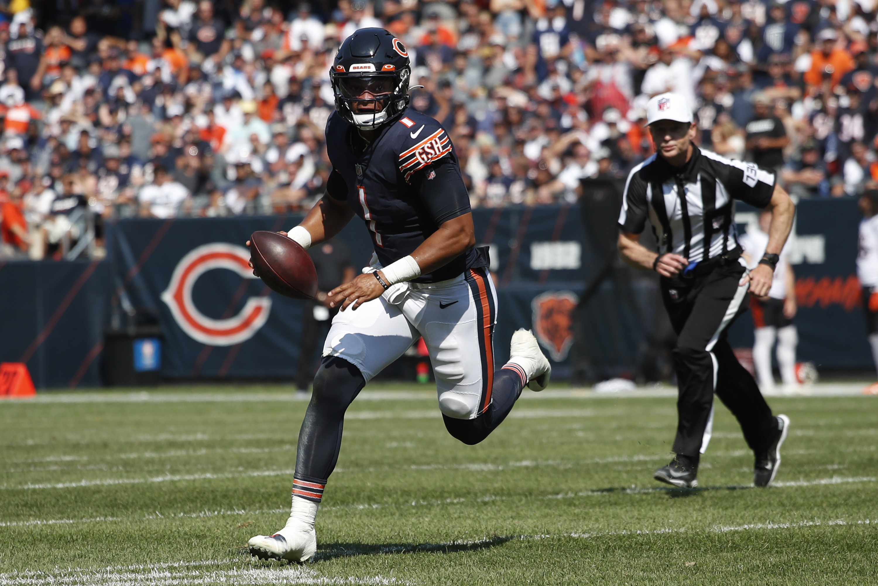 Bears quarterback Justin Fields (1) gained 35 yards on seven carries against the Bengals on Sunday, excluding three kneel-downs at the end of the game.