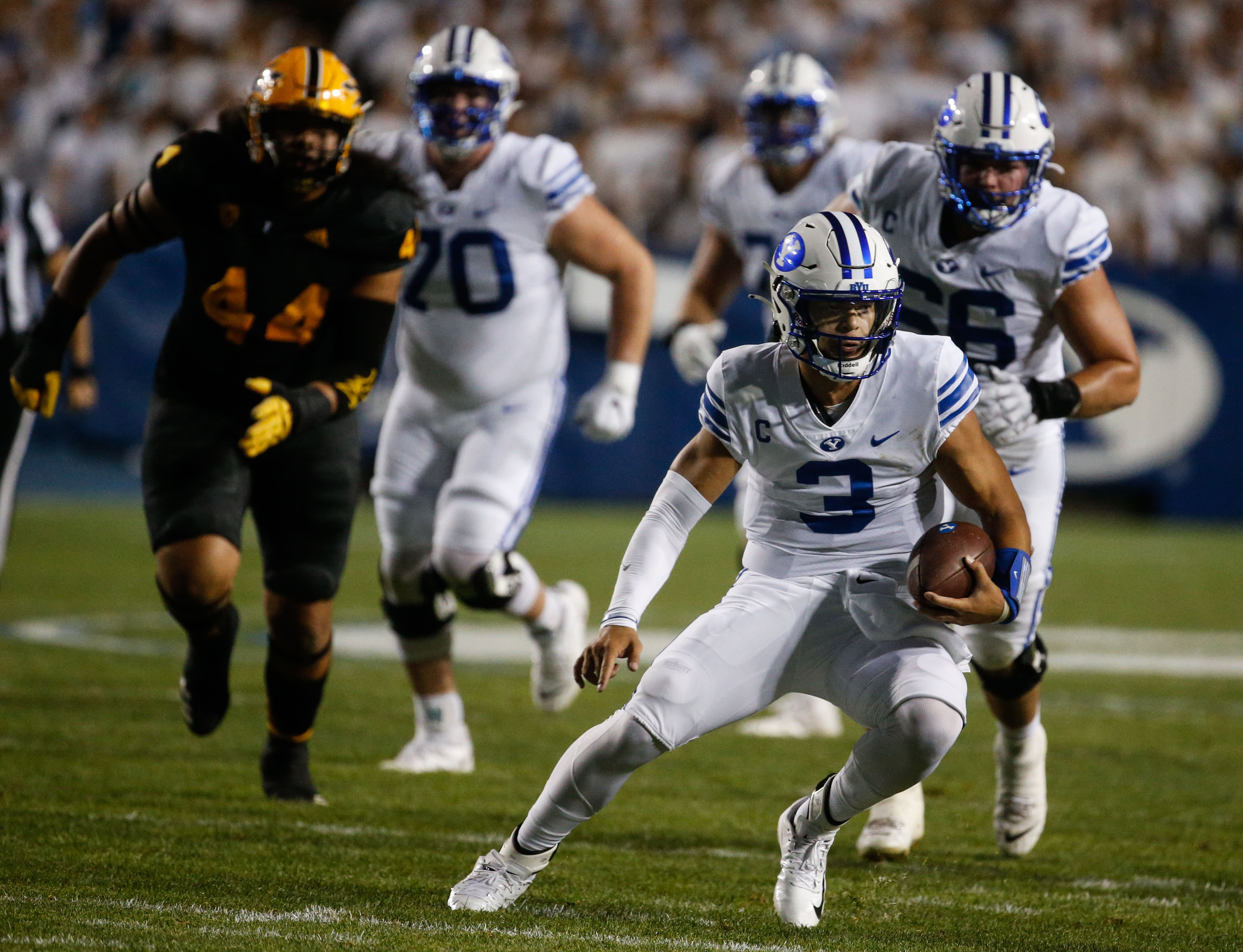 Brigham Young Cougars quarterback Jaren Hall (3) runs with the ball during an NCAA college football game against Arizona State.