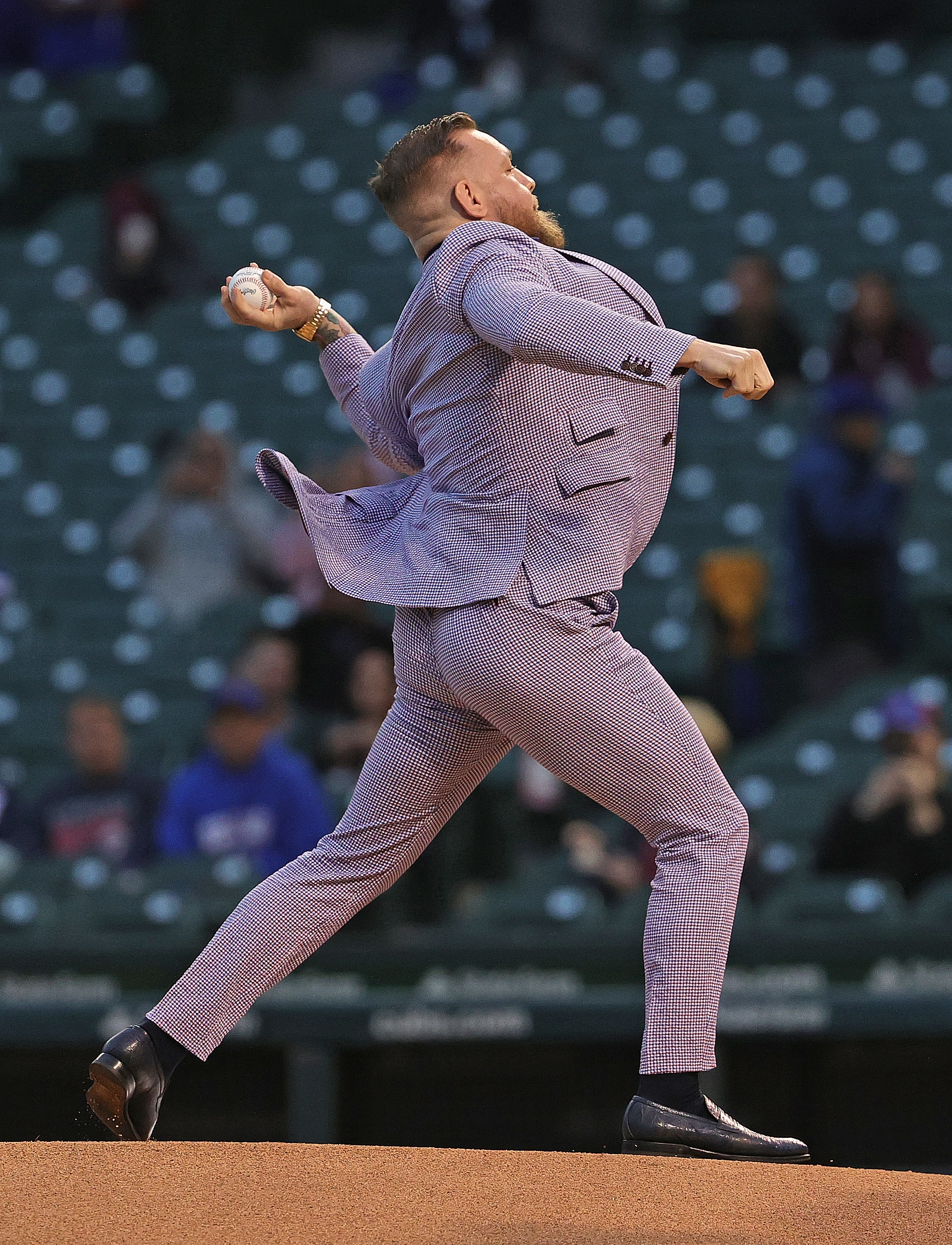 Conor McGregor throws out the ceremonial first pitch at the Cubs-Twins game on Tuesday.