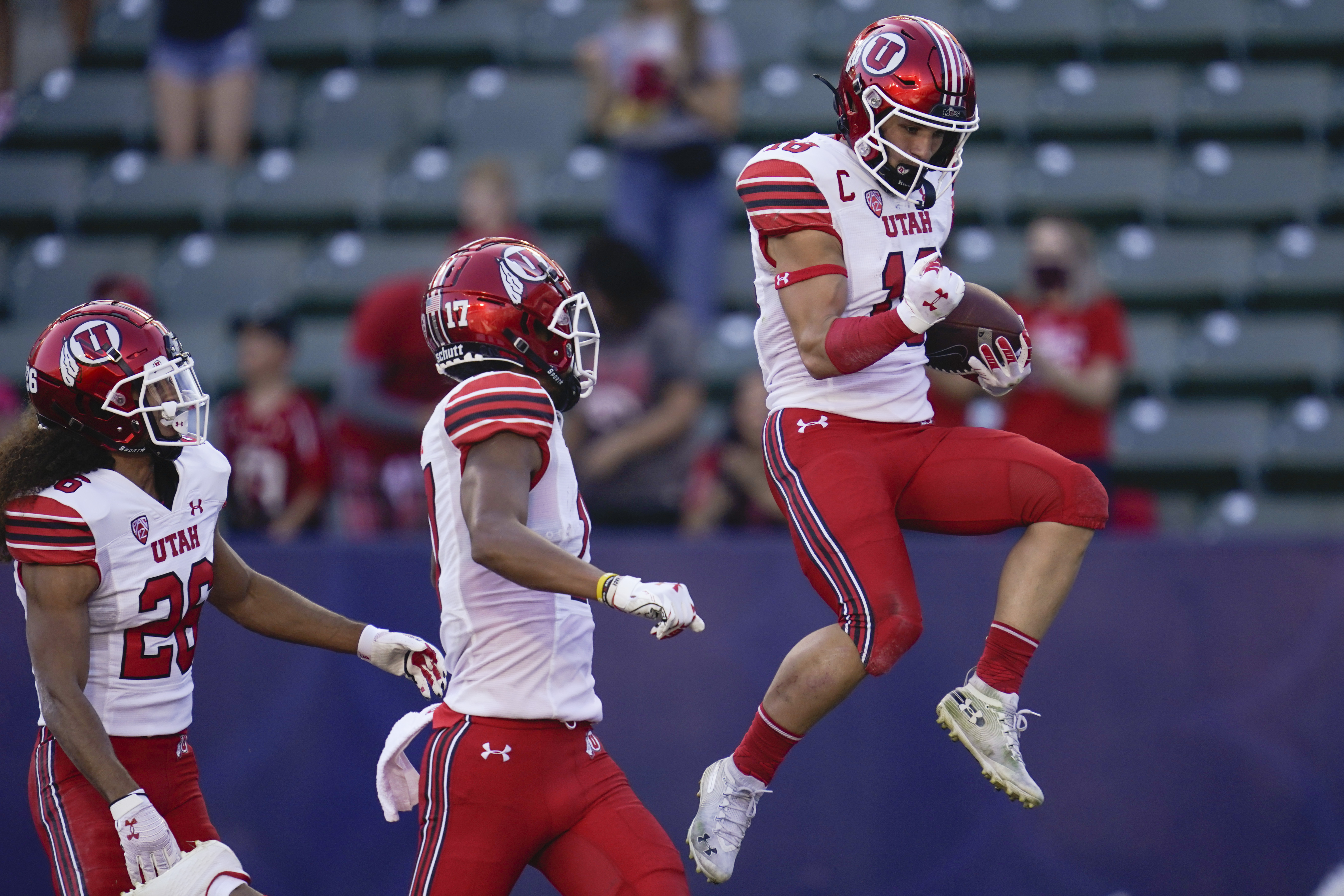Utah's Britain Covey celebrates after returning a punt for a TD during game against San Diego State in Carson, Calif.