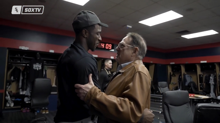 Chairman Jerry Reinsdorf congratulates Tim Anderson in the visitors clubhouse Thursday at Progressive Field after the White Sox clinched the AL Central title.