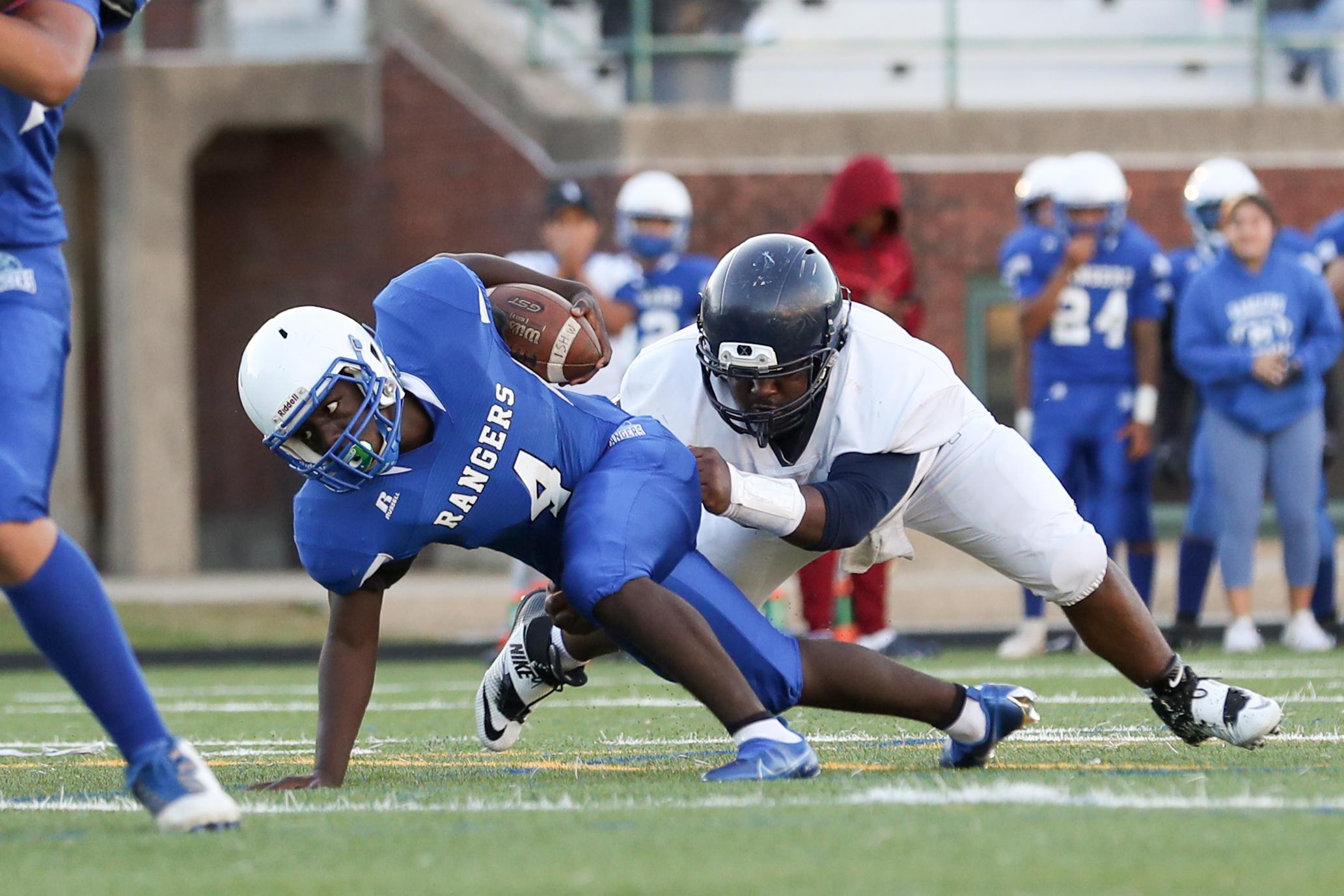 Mather's Jacob Scott (4) scrambles to get past Hyde Park's defense to score a touchdown.