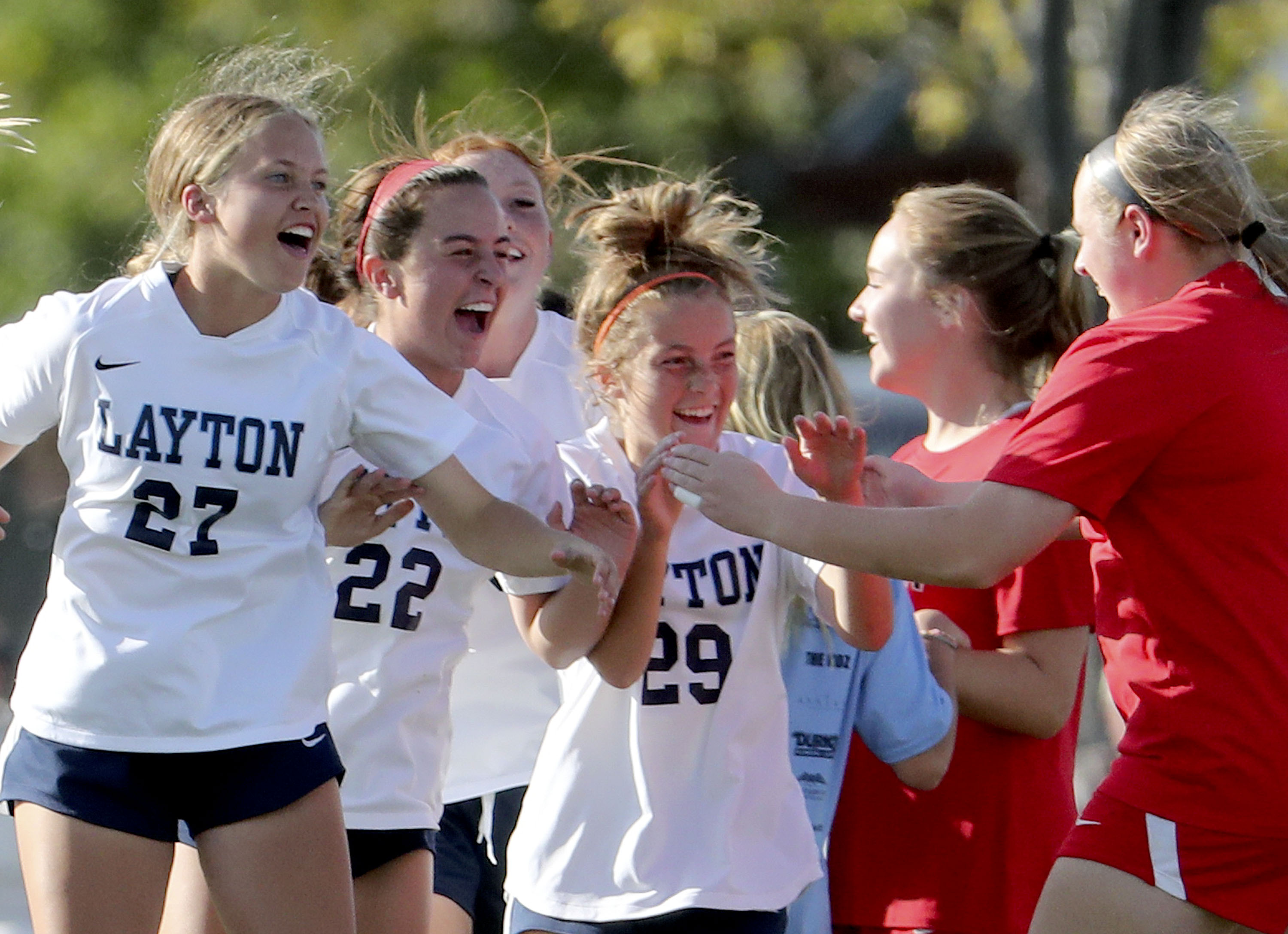 Layton players celebrate their win against Davis High at the Angel Street Soccer Complex in Kaysville on Thursday, Sept. 22, 2021.
