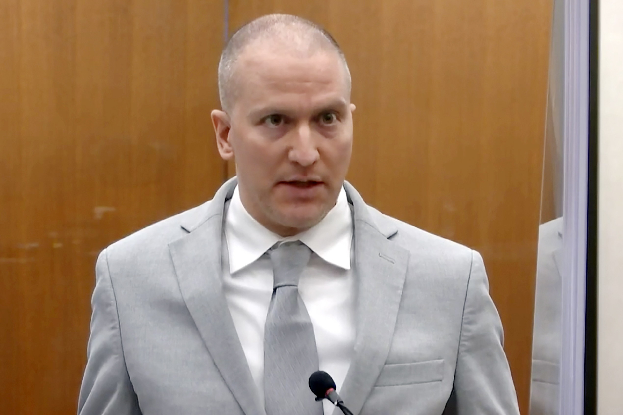 Former Minneapolis police Officer Derek Chauvin addresses the court as Hennepin County Judge PeterCahill presides over Chauvin's sentencing at the Hennepin County Courthouse.