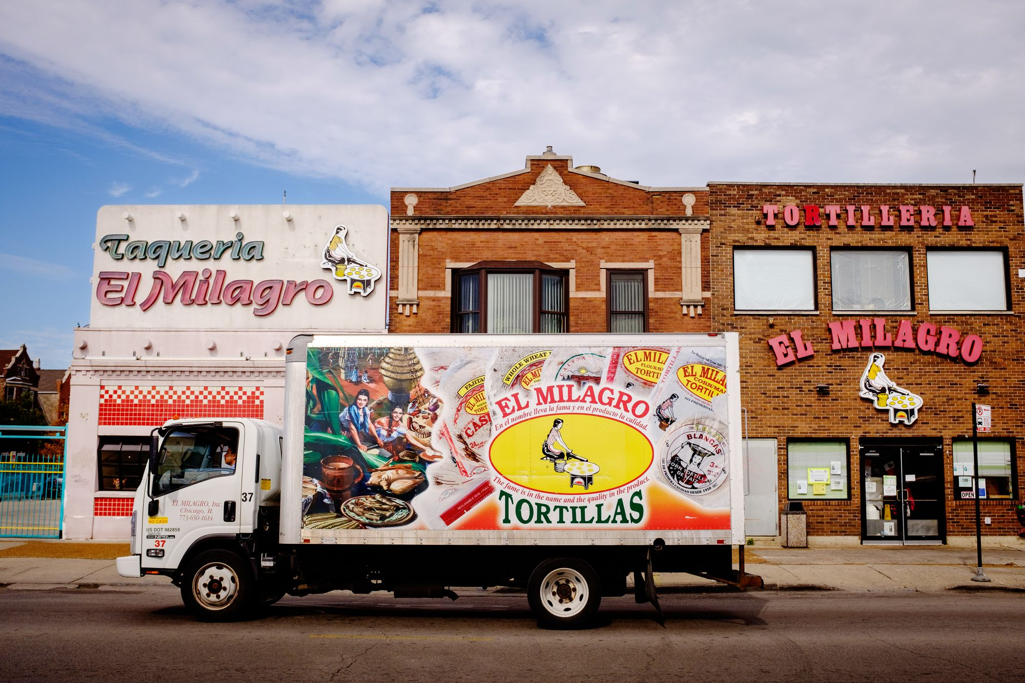 A tortilla truck parked on a street.
