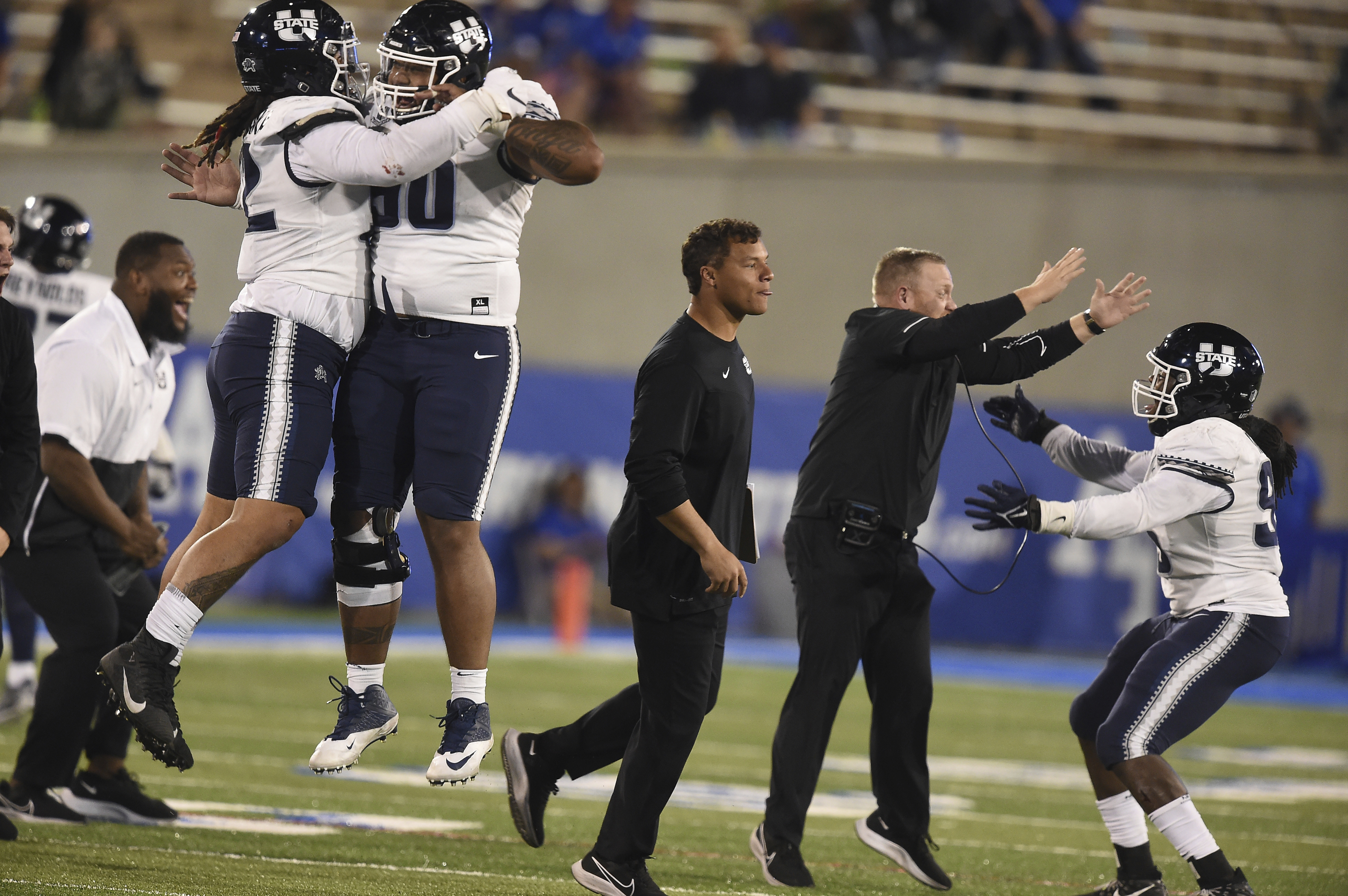 Utah State players and coaches celebrate after Air Force was stopped on fourth down.