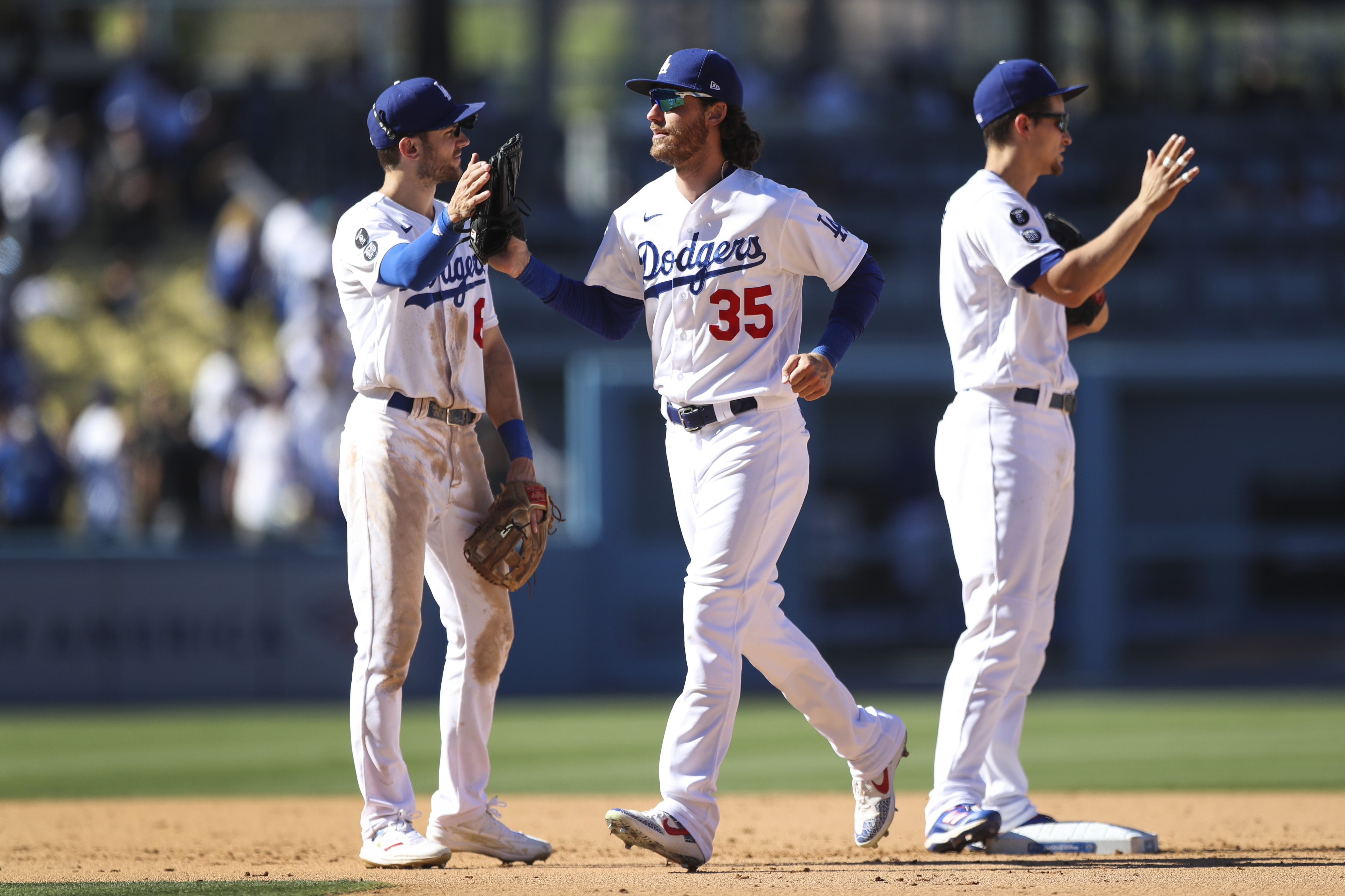 Cody Bellinger #35 of the Los Angeles Dodgers celebrates the win over the San Diego Padres with Trea Turner #6 at Dodger Stadium on September 12, 2021 in Los Angeles, California.