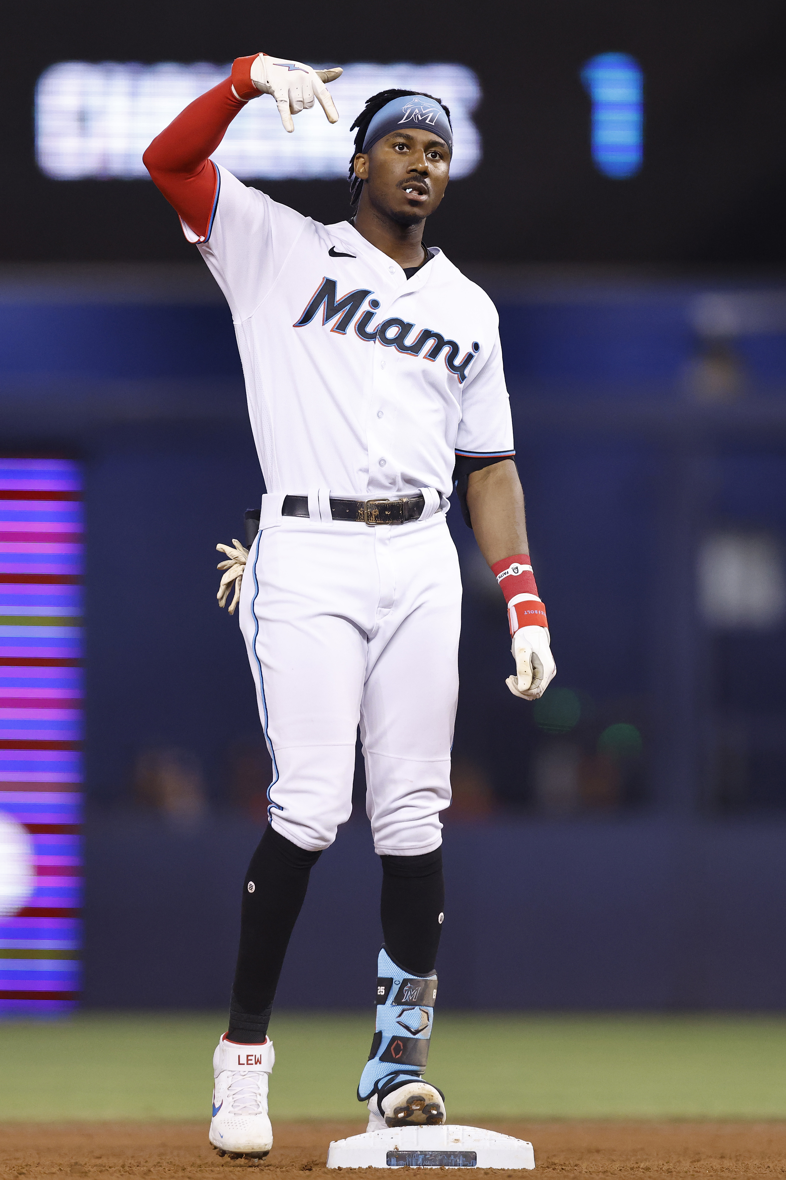 Lewis Brinson #25 of the Miami Marlins reacts after hitting a double during the fourth inning against the Washington Nationals at loanDepot park