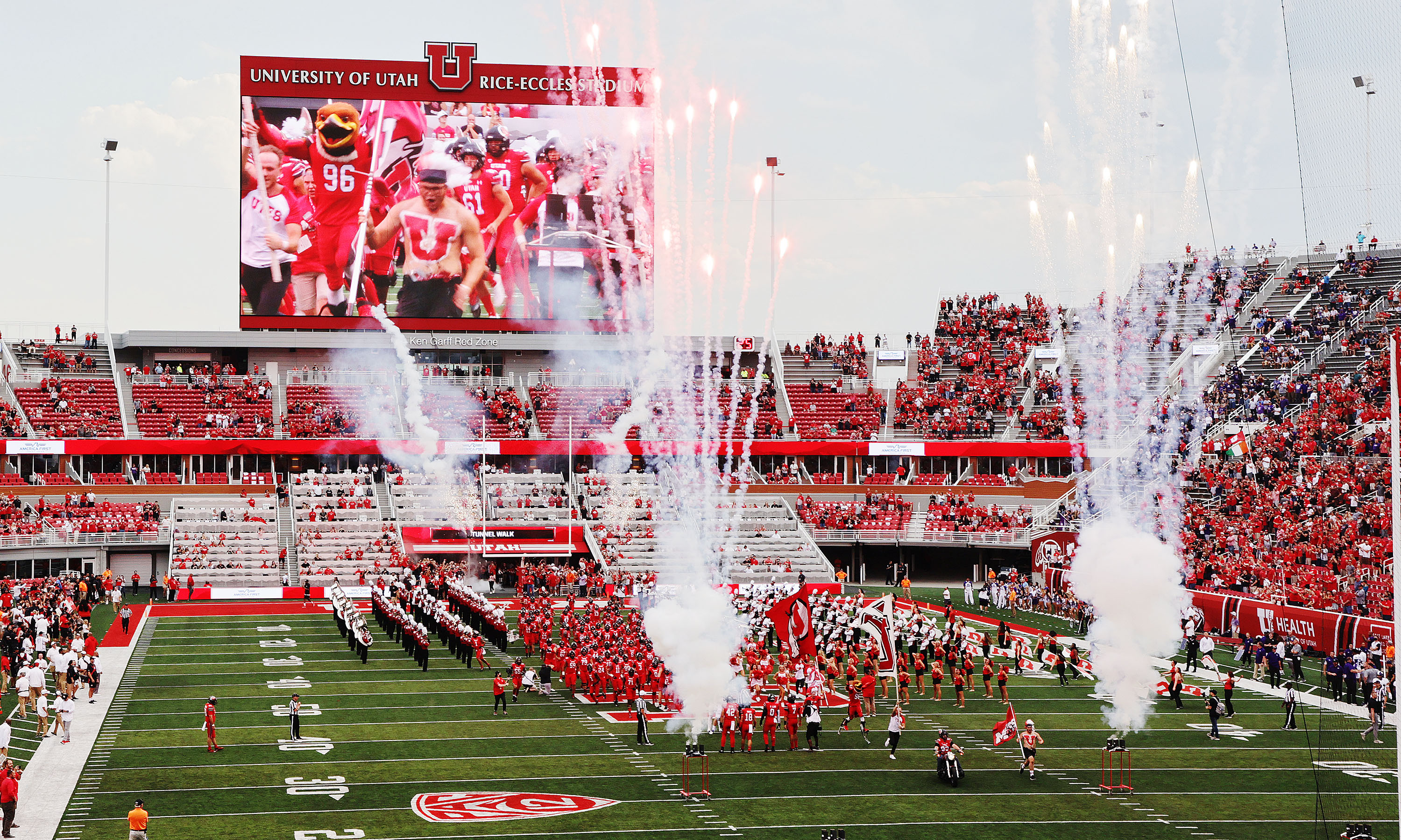 The Utes take the field at Rice-Eccles Stadium in Salt Lake City.