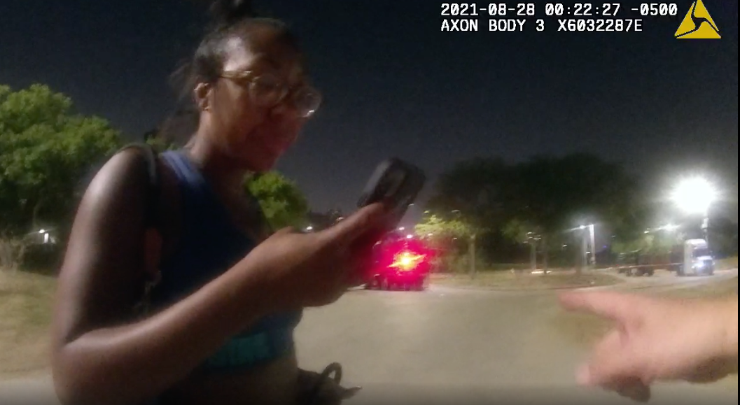 Still image from body-worn camera footage of Nikkita Brown seconds before a CPD officer attempts to restrain her in an August encounter that began as she was walking her dog after park hours along the lakefront.