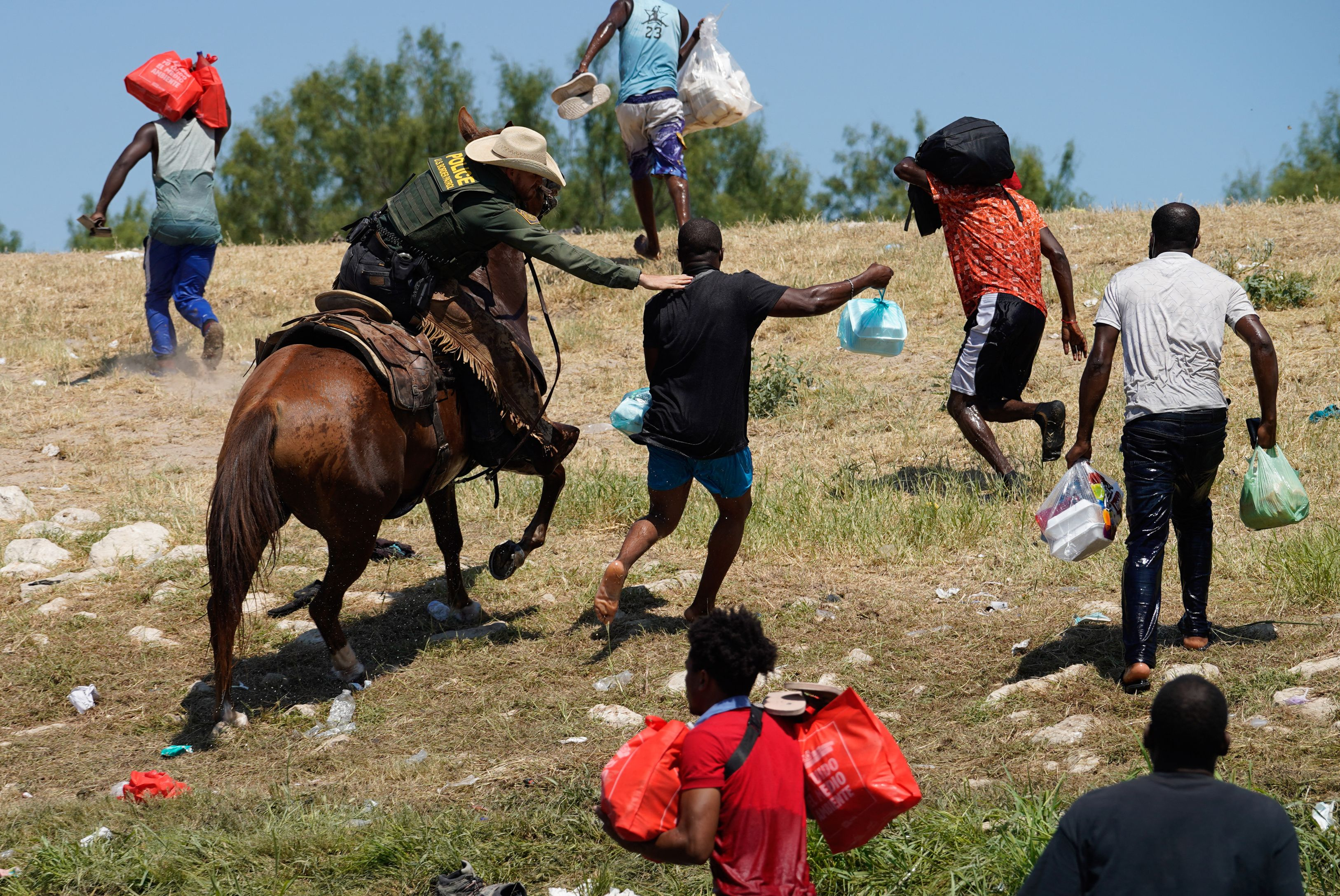 A U.S. Border Patrol agent on horseback tries to stop a Haitian migrant from entering an encampment on the banks of the Rio Grande River Sept. 19 near the Acuna Del Rio International Bridge in Del Rio, Texas.