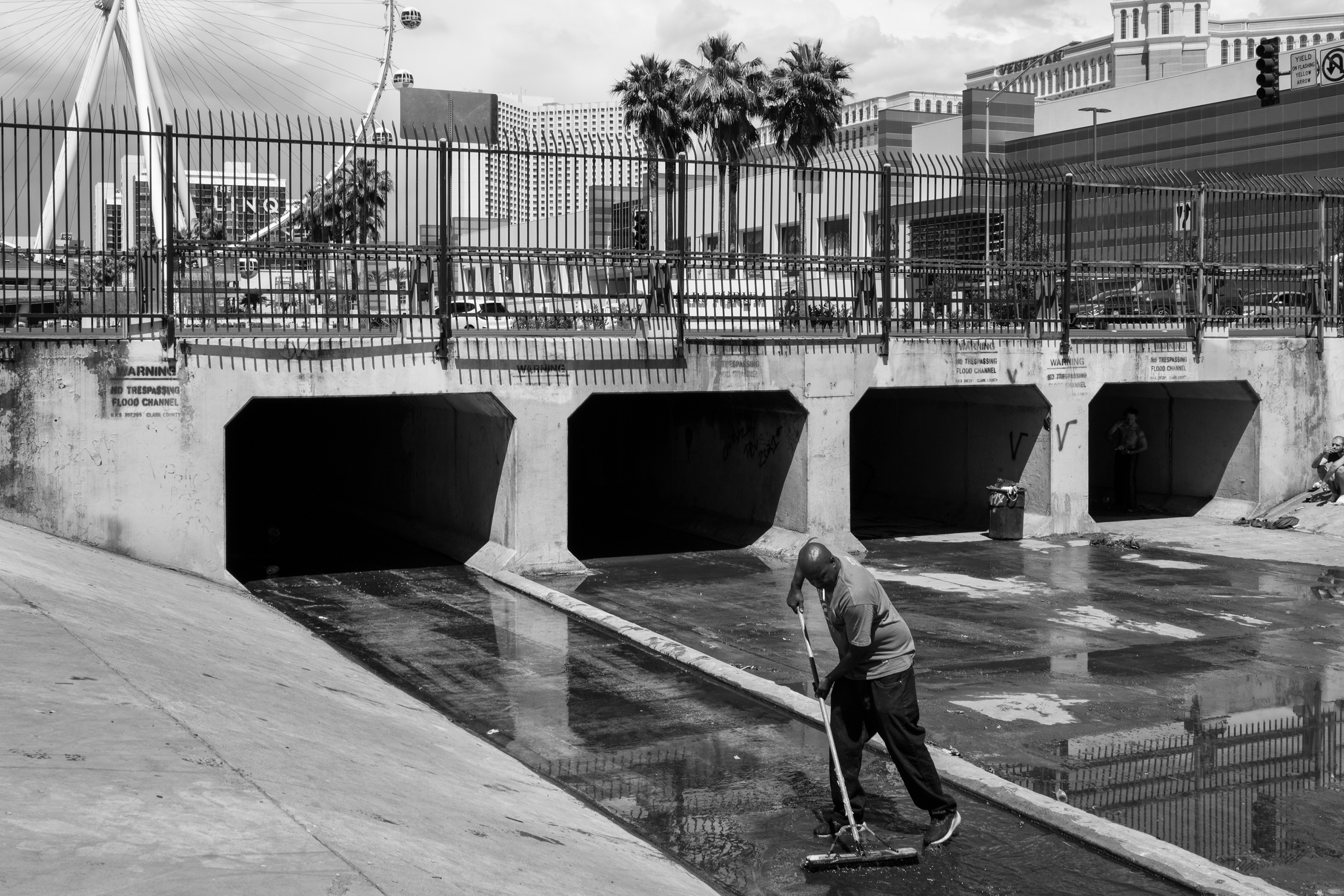 A man sweeps water from a tunnel near Caesars Palace in Las Vegas.