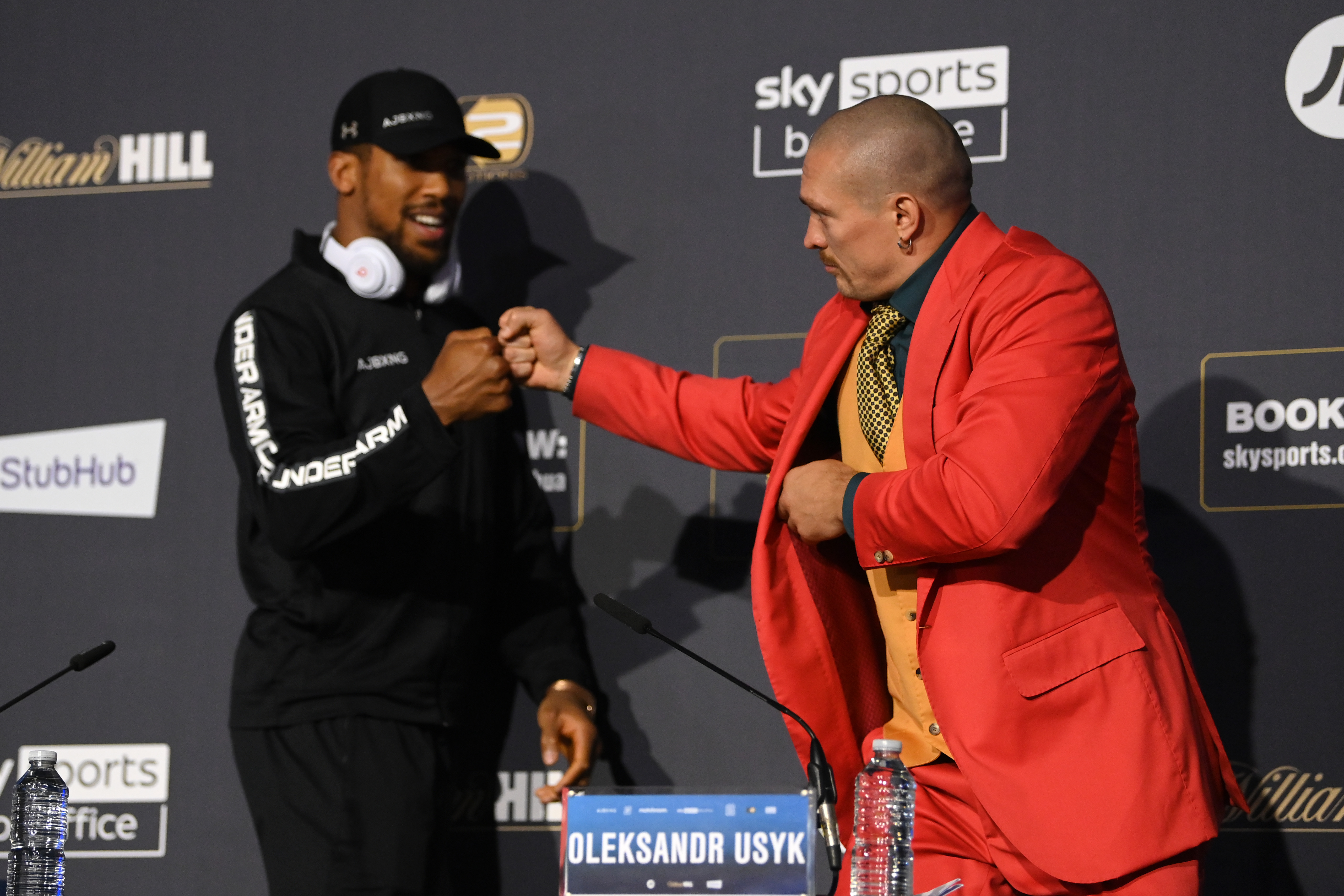 Anthony Joshua and Oleksandr Usyk bump fists during a Press Conference ahead of the heavyweight fight between Anthony Joshua and Oleksandr Usyk at Tottenham Hotspur Stadium on September 23, 2021 in London, England.