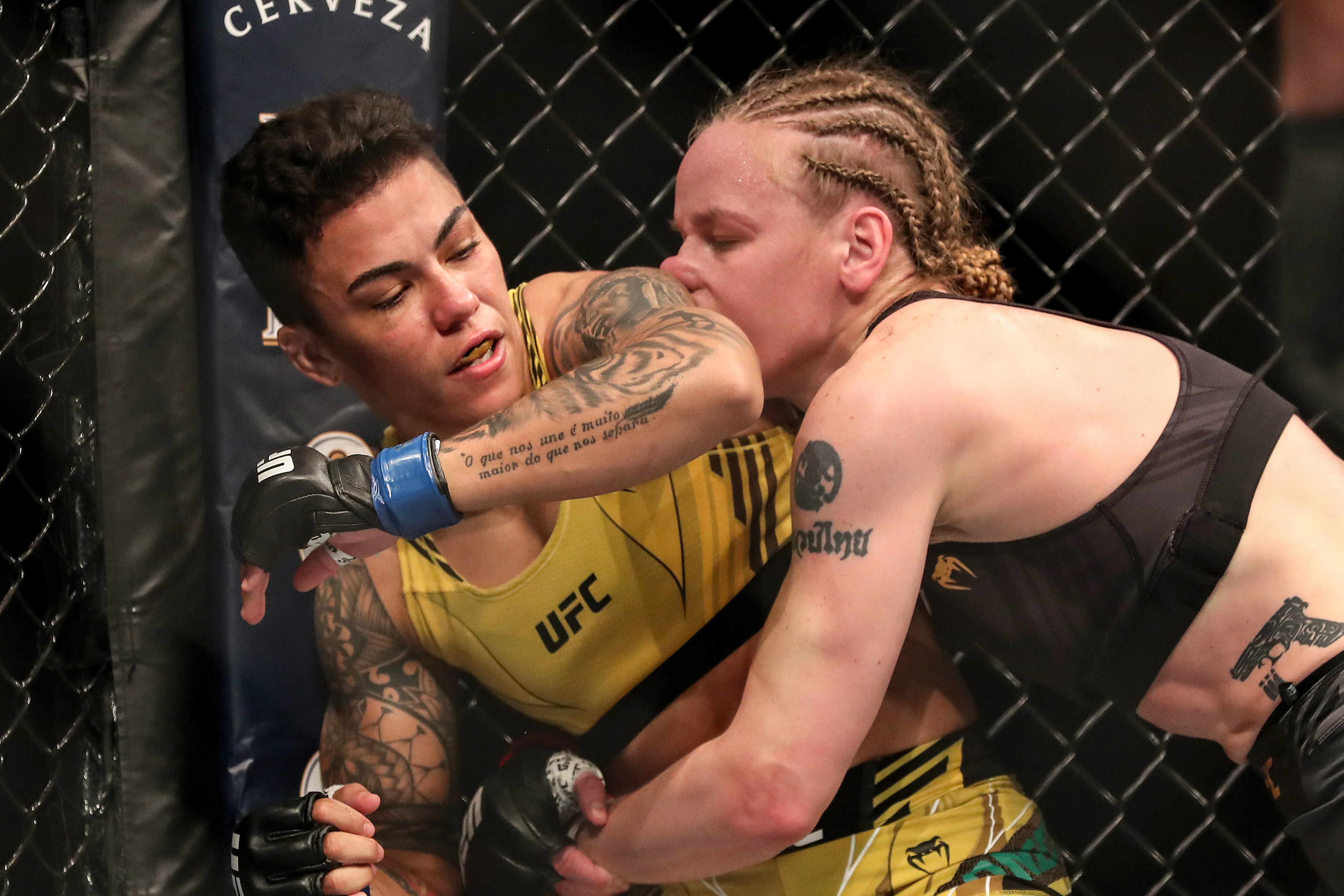 Valentina Shevchenko of Kyrgystan takes an elbow from Jessica Andrade of Brazil during the Women's Flyweight Title bout of UFC 261 at VyStar Veterans Memorial Arena