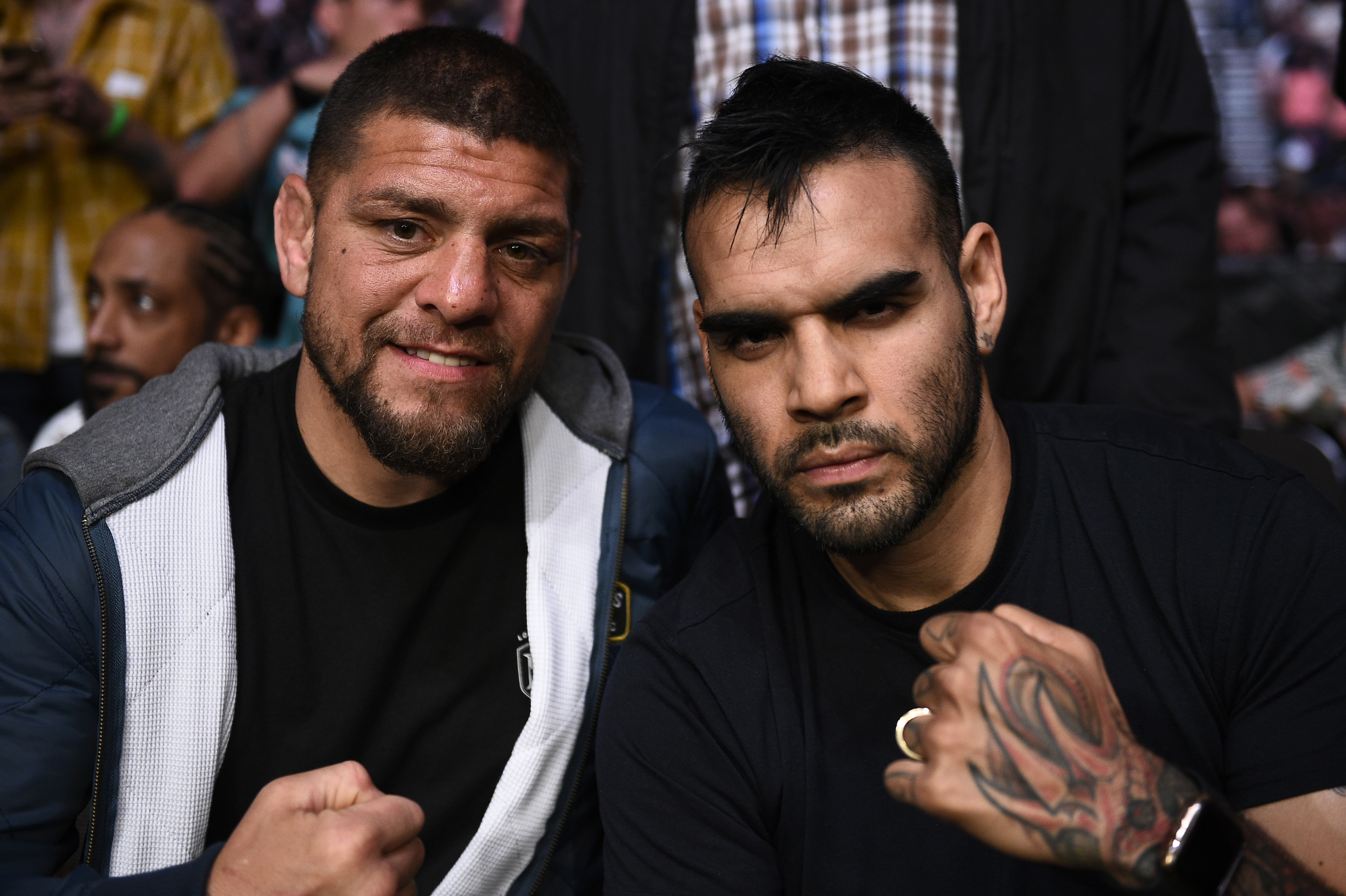 Nick Diaz (L) and guest Martin Sano are seen attending the UFC 261 event at VyStar Veterans Memorial Arena on April 24, 2021 in Jacksonville, Florida