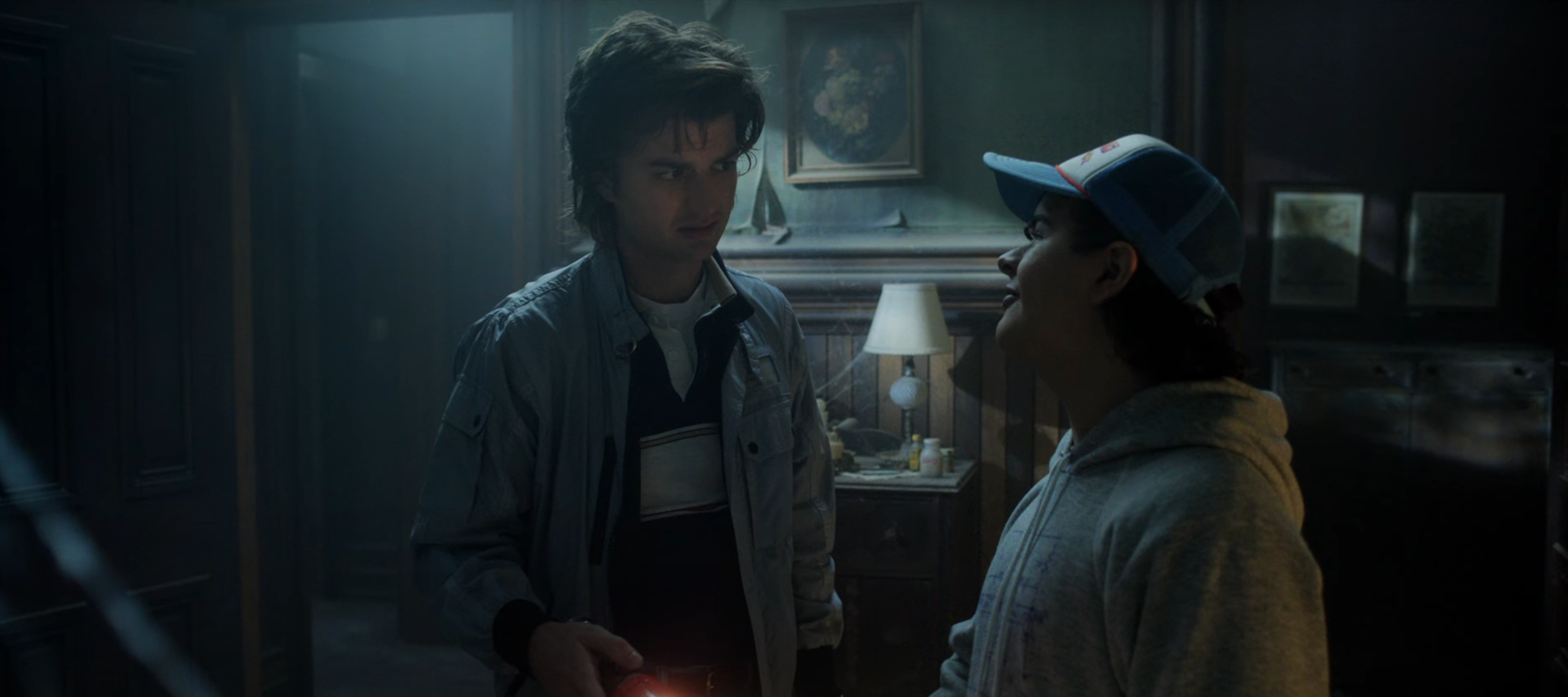 Steve and Dustin in a haunted house from Stranger Things season 4