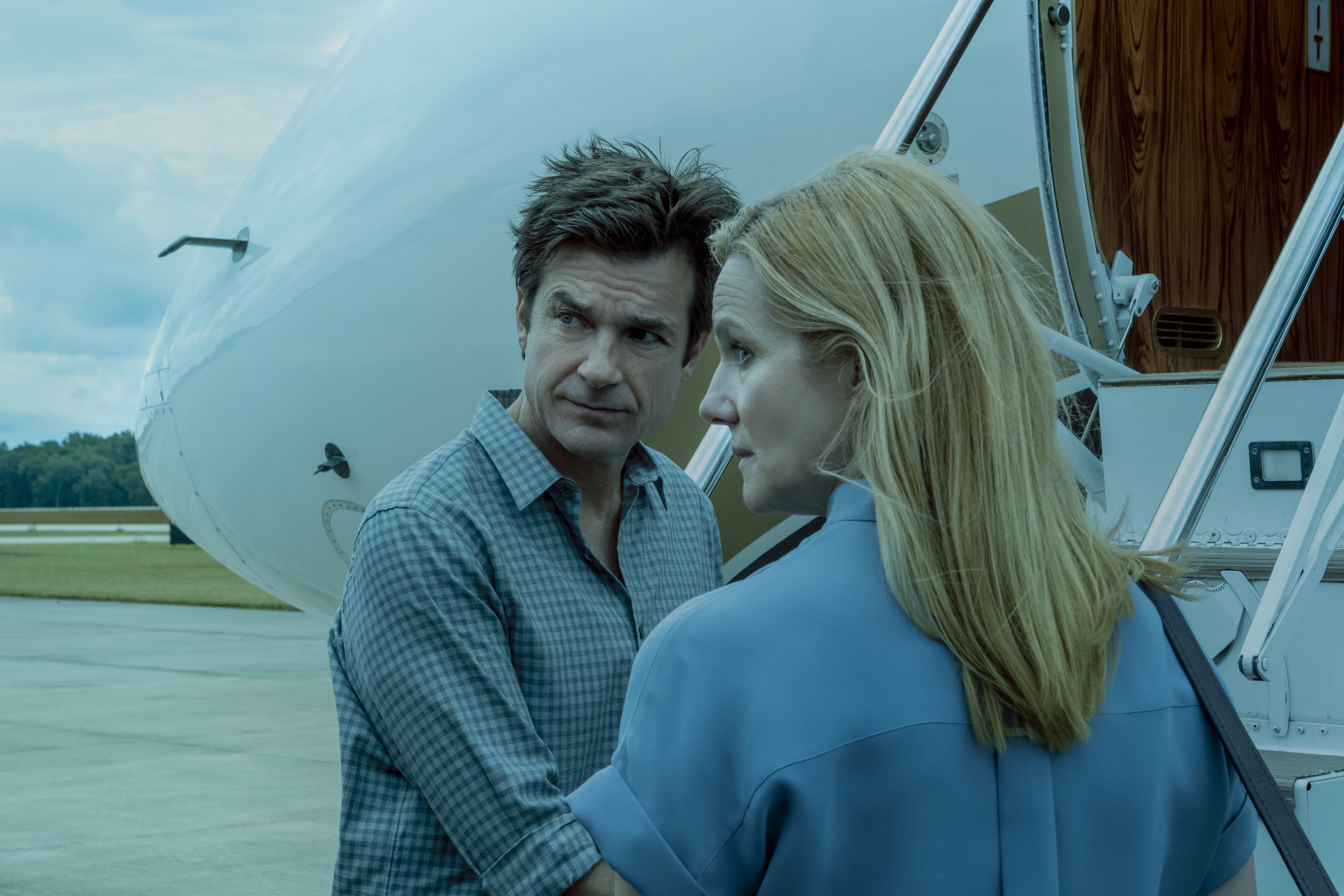 Marty and Wendy Byrde (Jason Bateman and Laura Linney) board an airplane in a still from Netflix's Ozark.