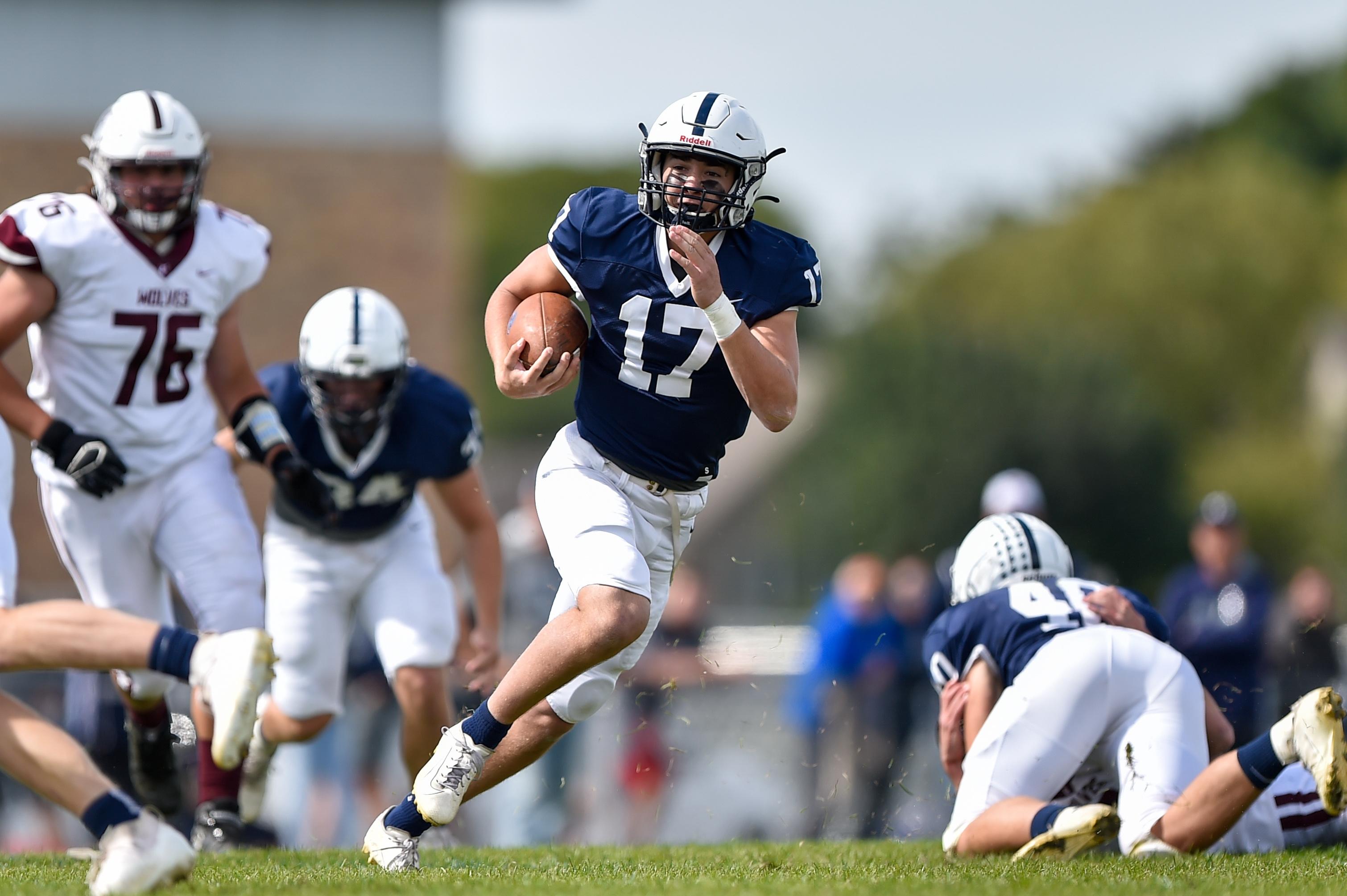 Cary-Grove's Jameson Sheehan (17) runs the ball against Prairie Ridge.